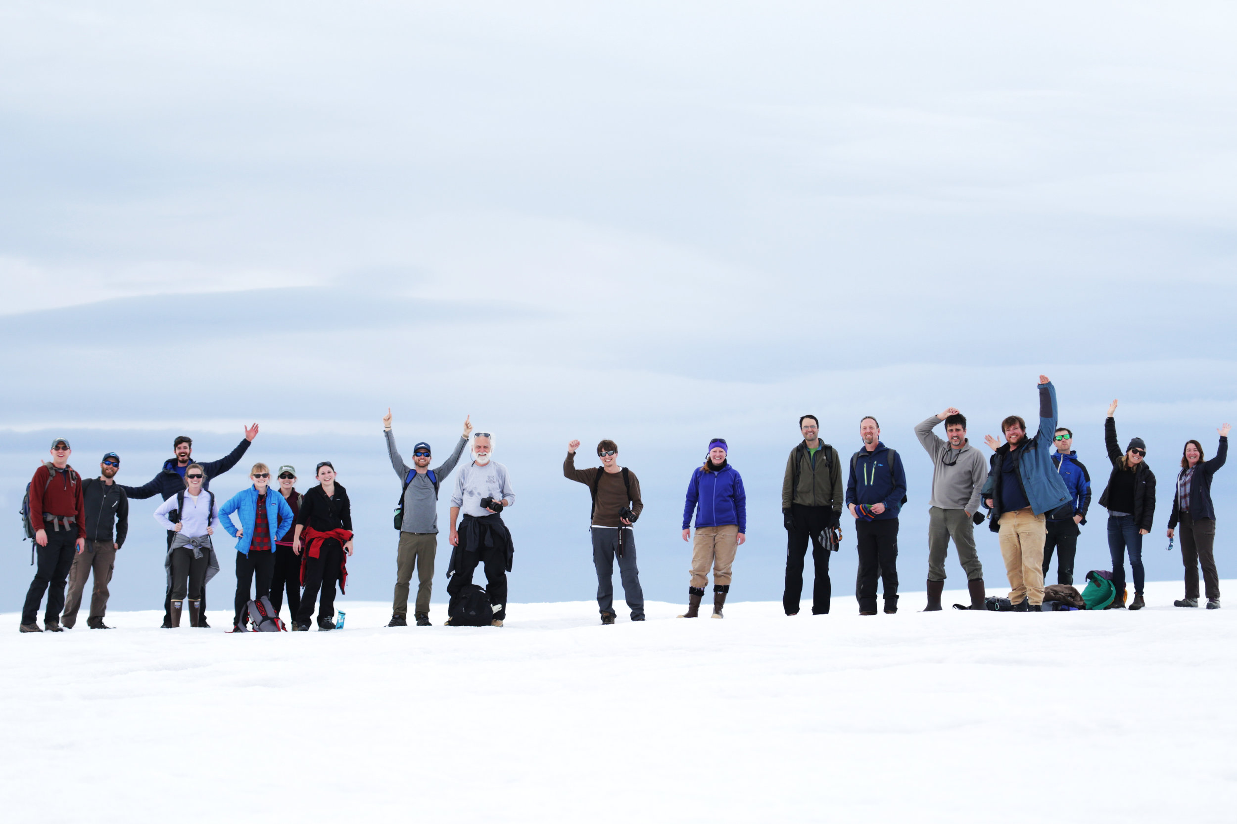 A group of biologists, geologists, and marine technicians gather on the glacier behind Palmer Station, Antarctica | February 2018