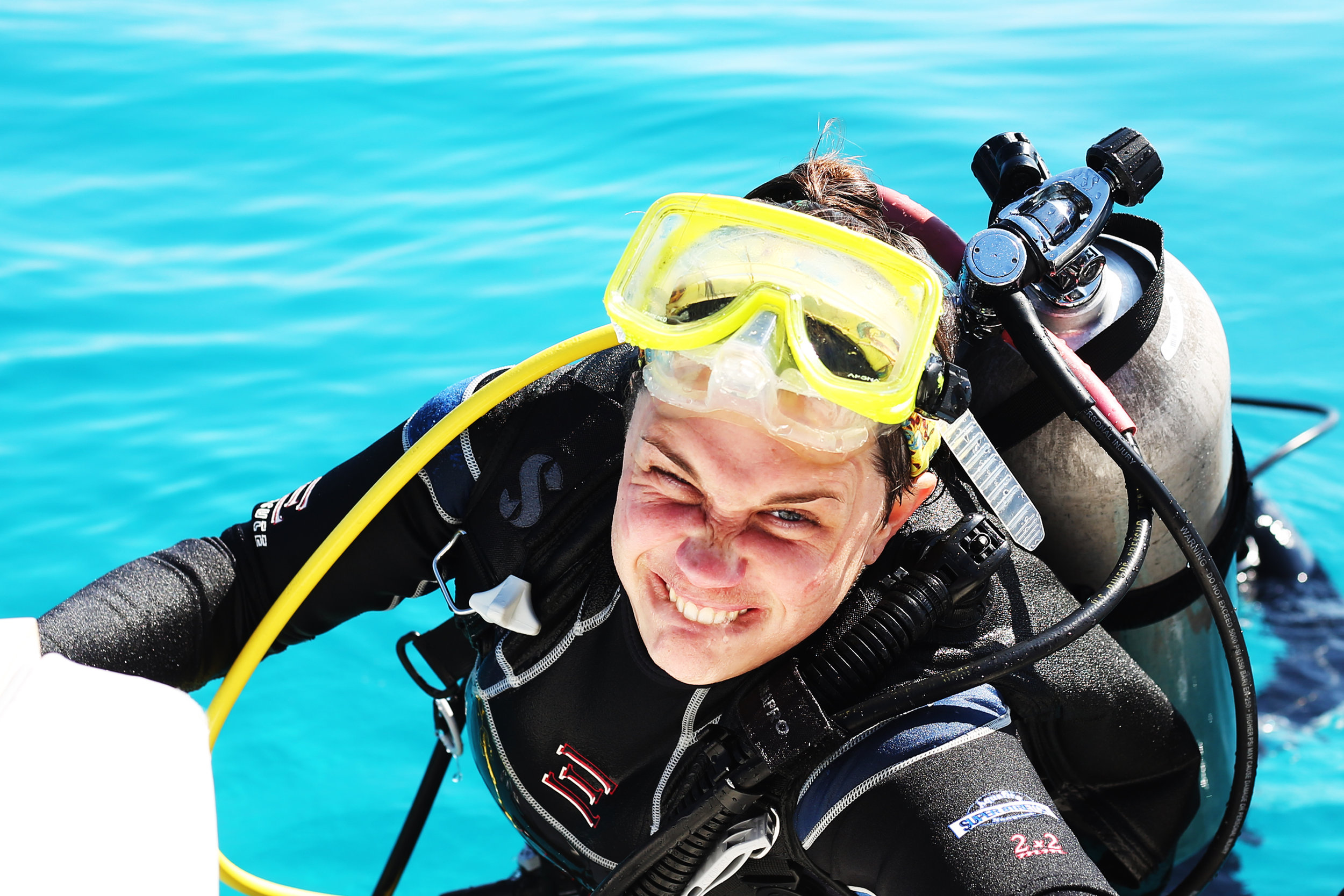 Kate Gould clambers out of the water after an hour of collecting and tagging corals near Key Largo, Florida | February 2019
