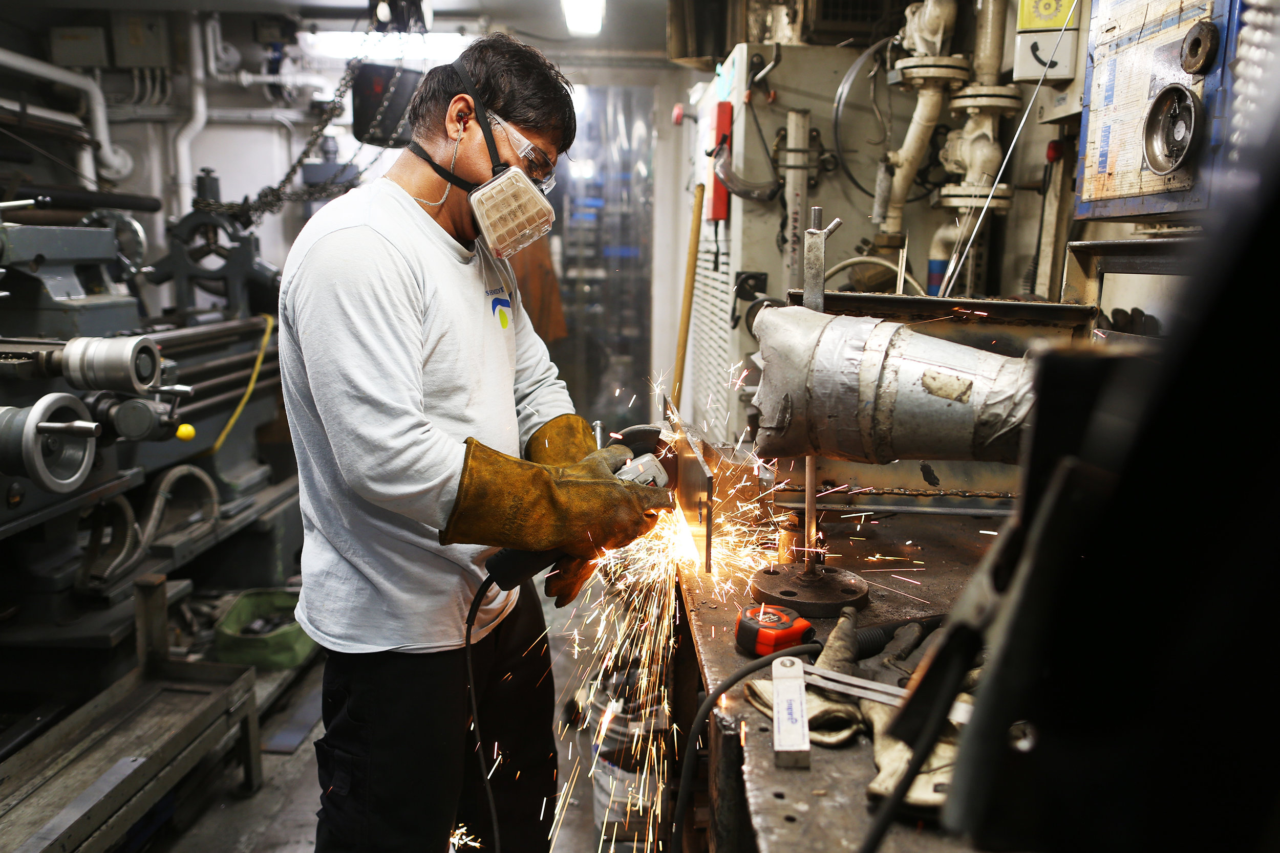 Fitter Albert Barcelo fabricates a new part for a piece of scientific equipment in the engine room workshop of R/V  Falkor  | July 2018