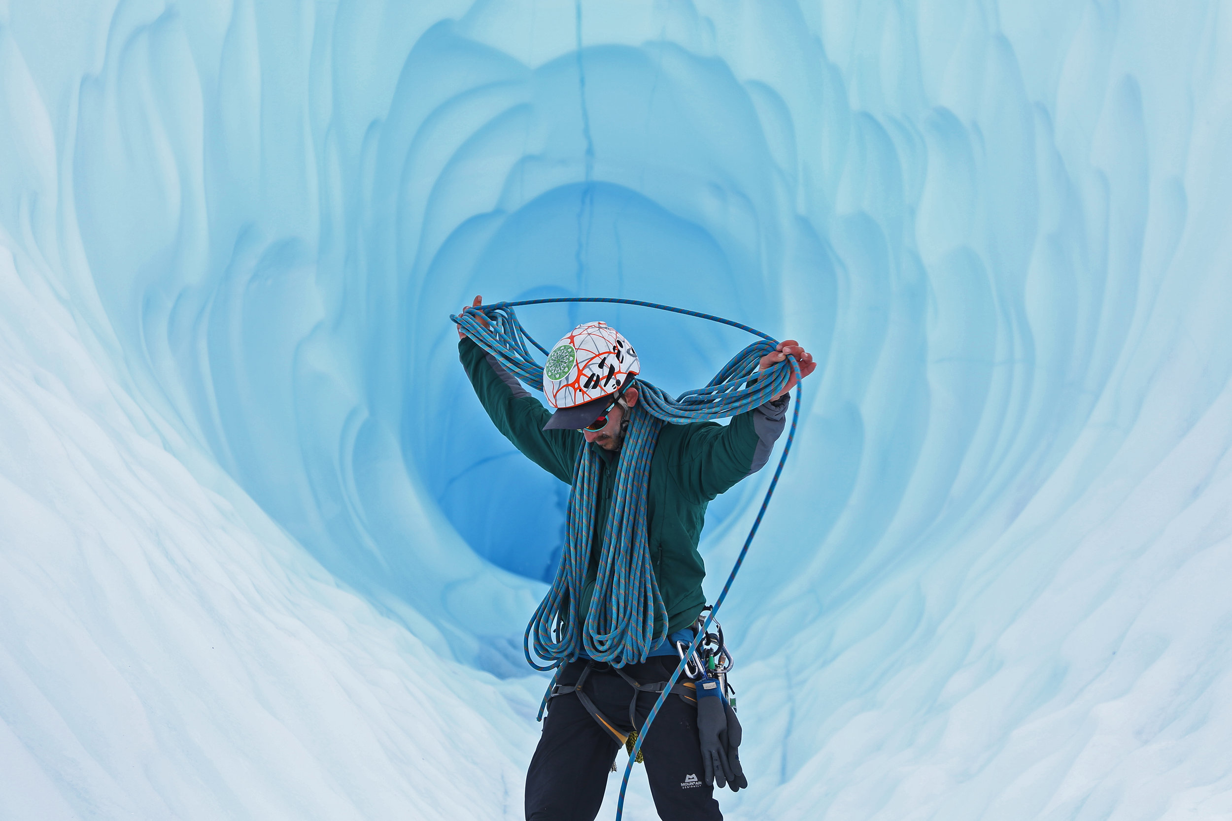 Brett Ryne coils a rope after climbing an ice wall at the Matanuska Glacier in Alaska | July 2019