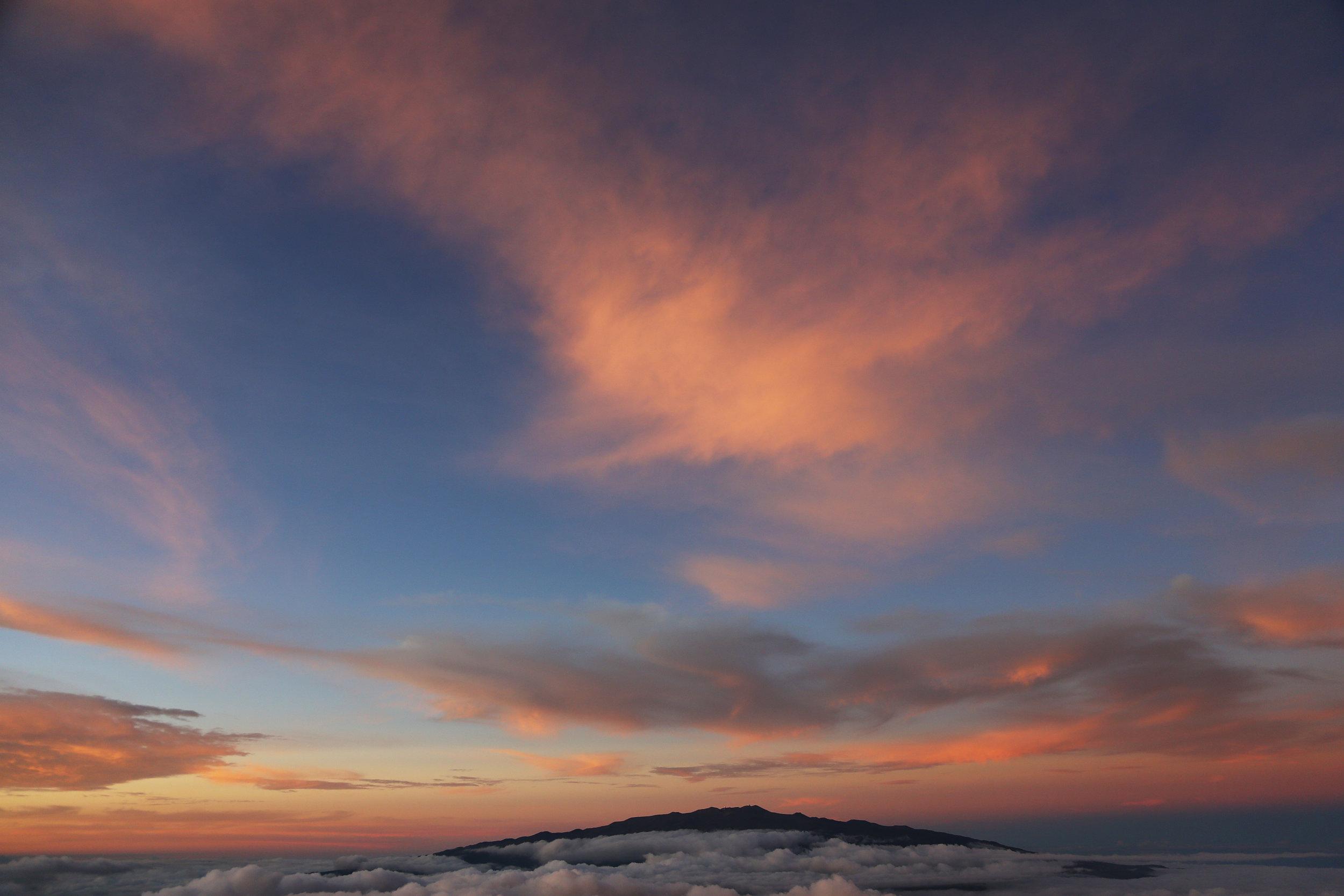 View of Mauna Kea at sunset from high on Mauna Loa