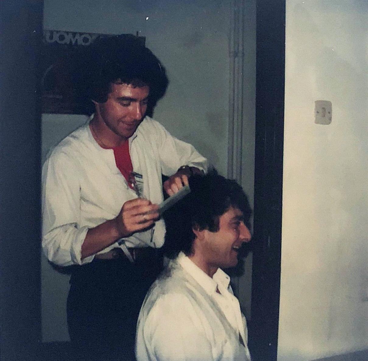 Michael cutting Aldo Coppola's hair