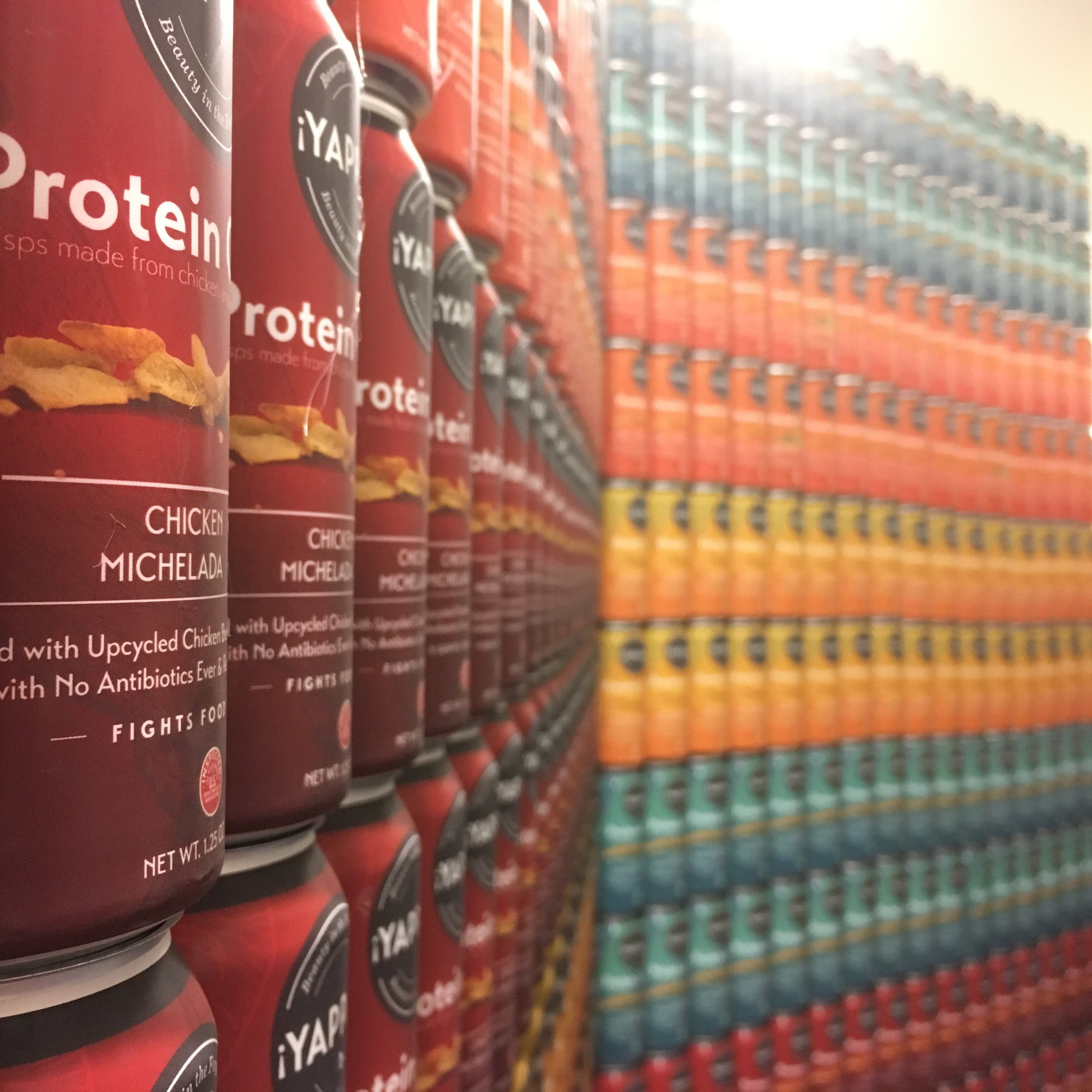 Cans of  ¡Yappah!  ready to roll out, the result of our partnership with the in-house innovation team of a major protein company.