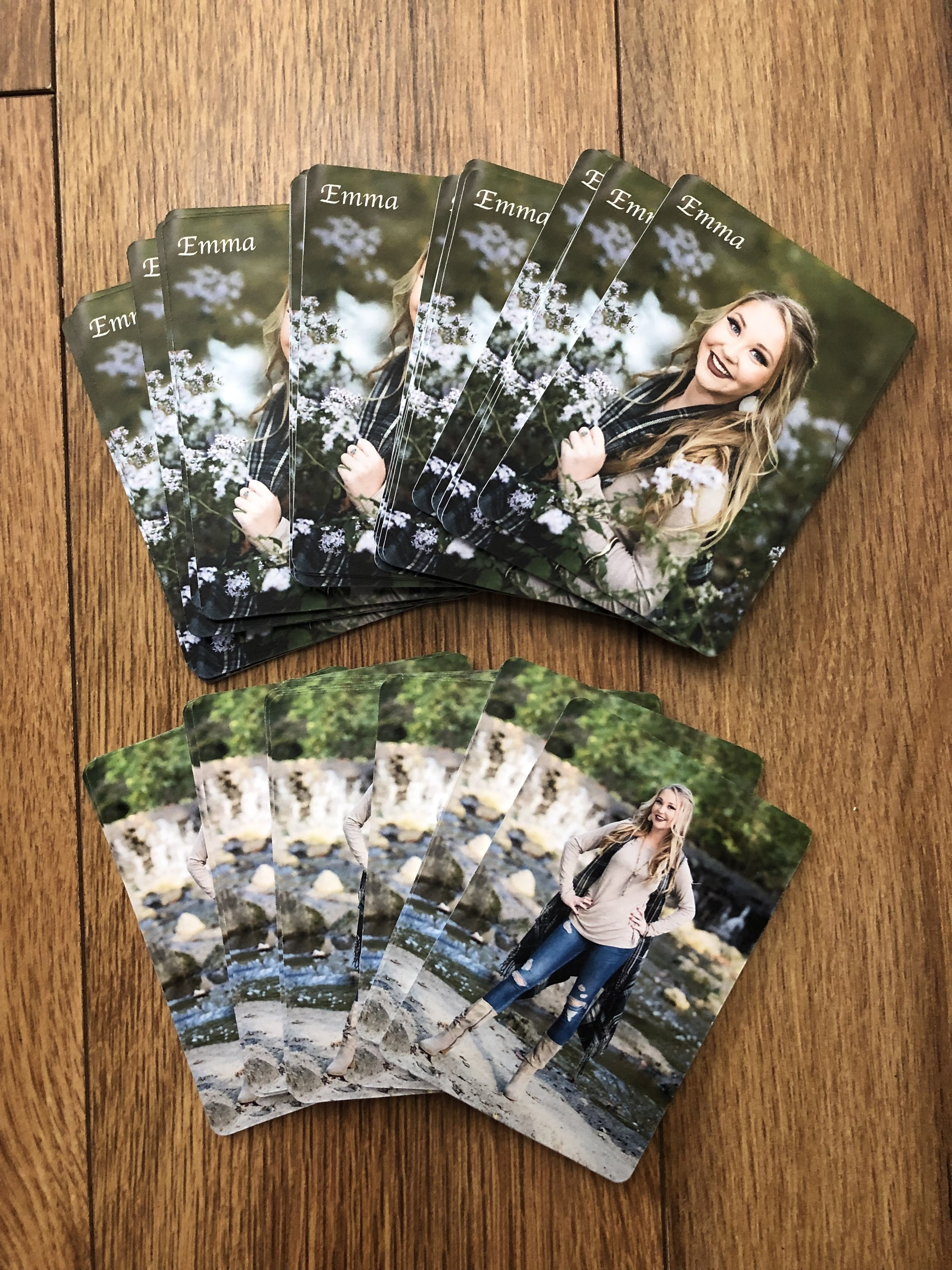 Double sided wallets can have names, year graduation or other words at the corner of any side. This particular photos we just did her name on one side. Double sided wallets come in sets of 50 only.