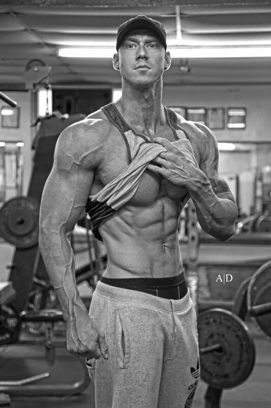 Fitness coach Kyle Grosshanten displaying his muscles
