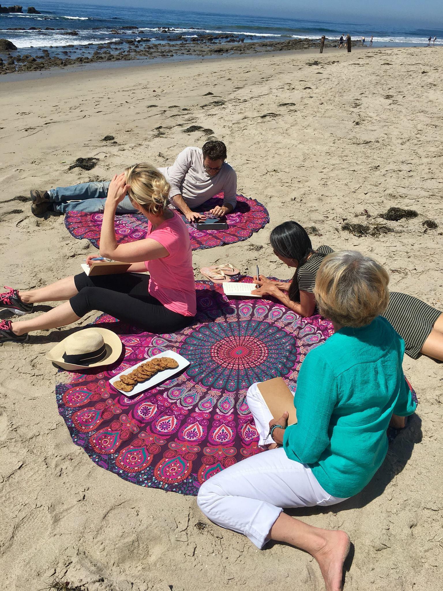 People writing on the beach.jpg