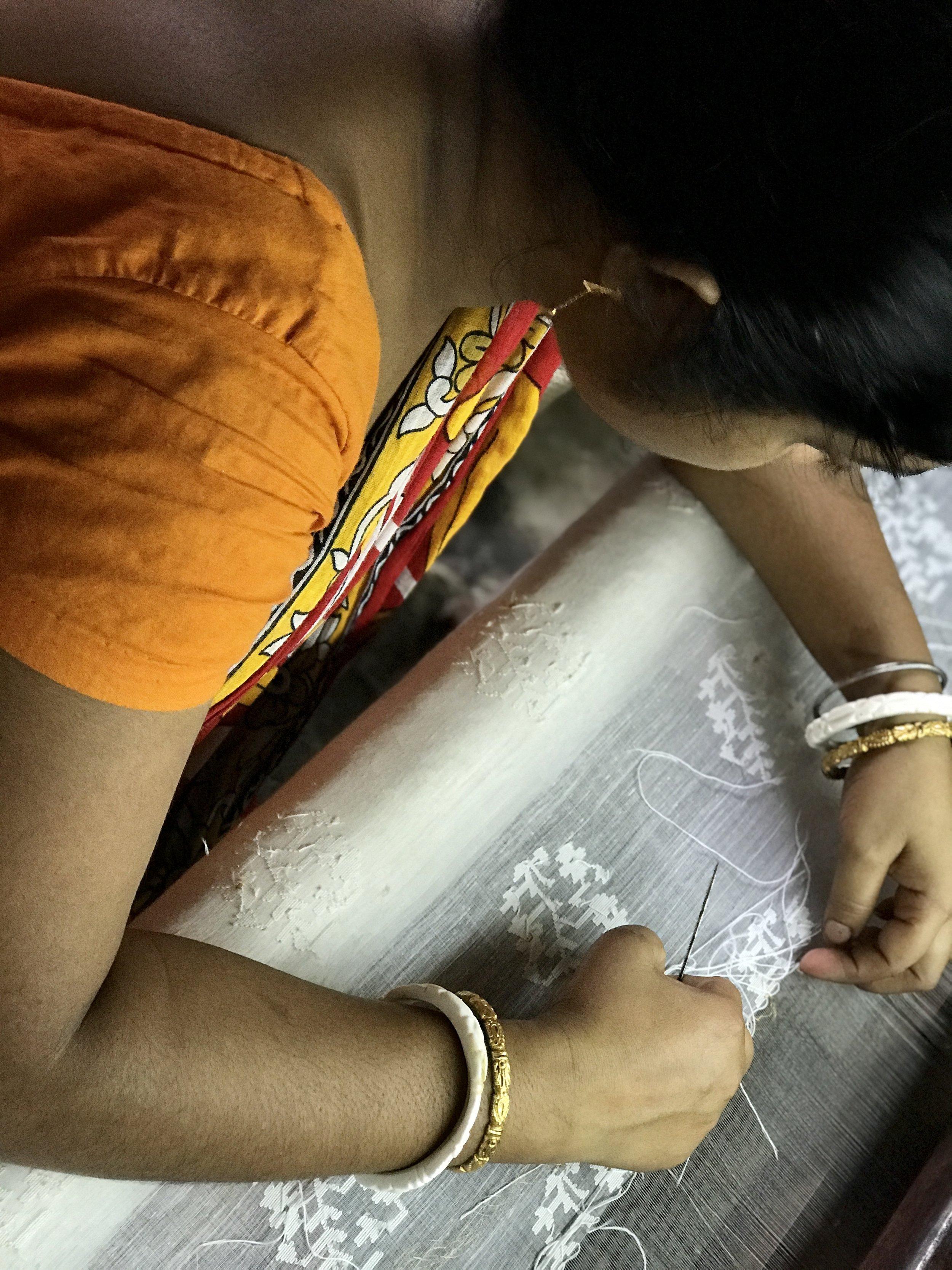 WHITE ON WHITE: Floral  Jamdani  motifs being woven on fine  muslin