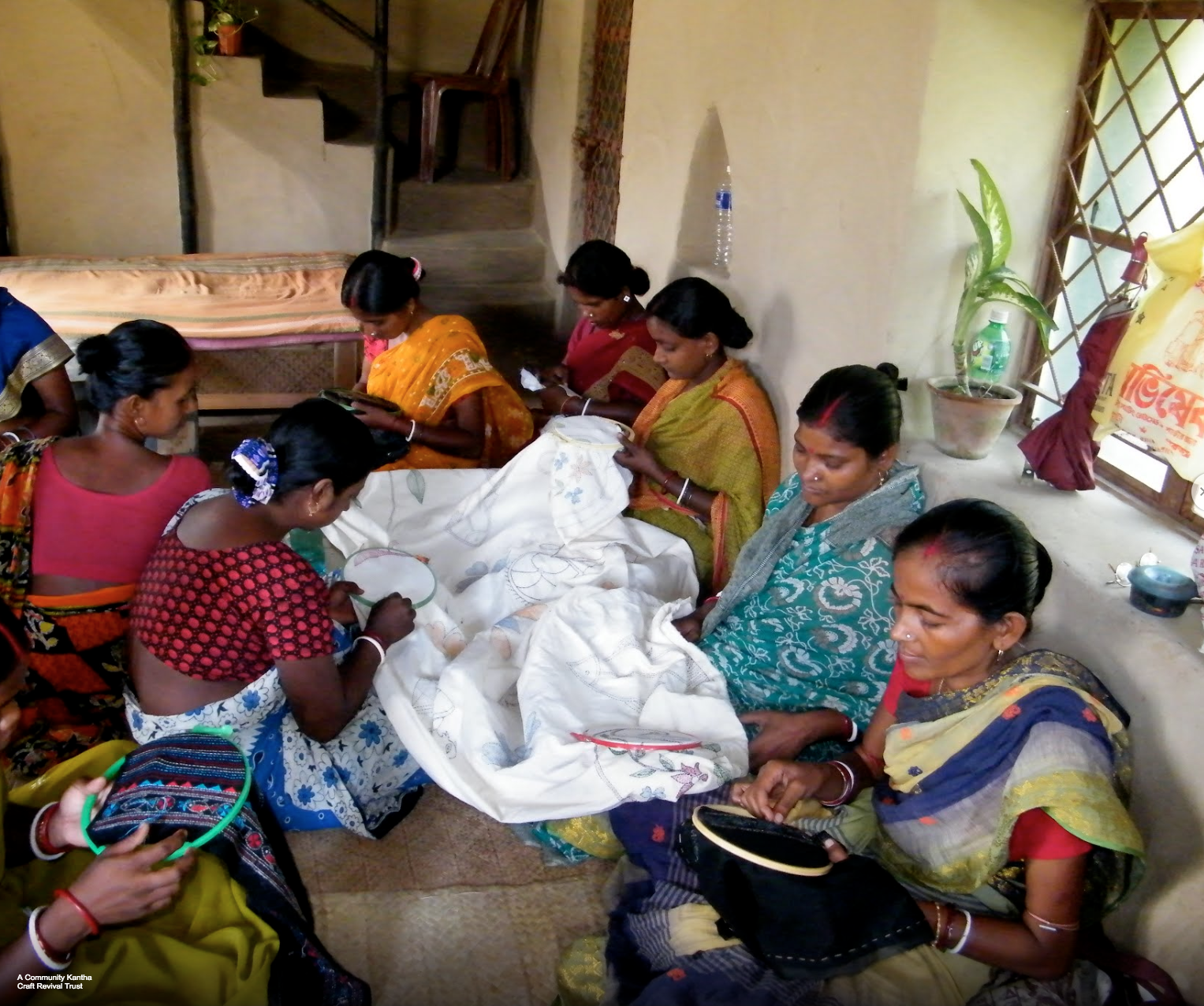 Women stitching  Kantha  garments in a village in West Bengal, India. Pic courtesy: Google Arts & Culture