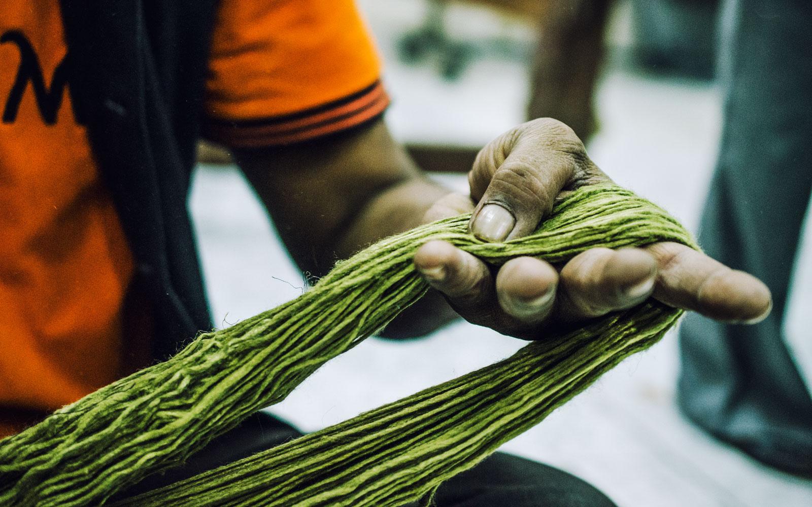 A master weaver prepares yarn at designer maker Gaurav Jai Gupta's studio.