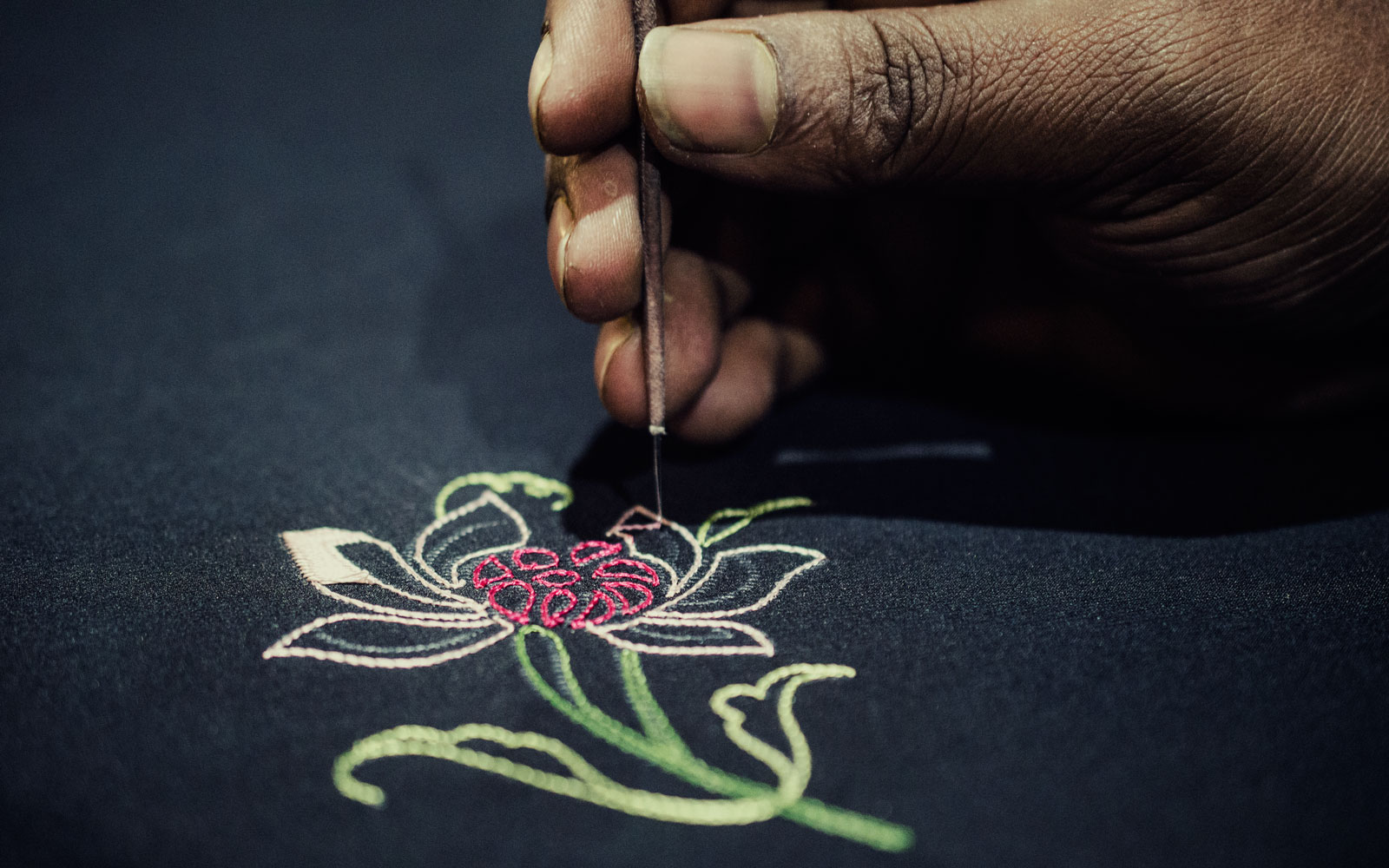 A master craftsman embroiders a Gara sari at designer Ashdeen Lilaowala's studio.