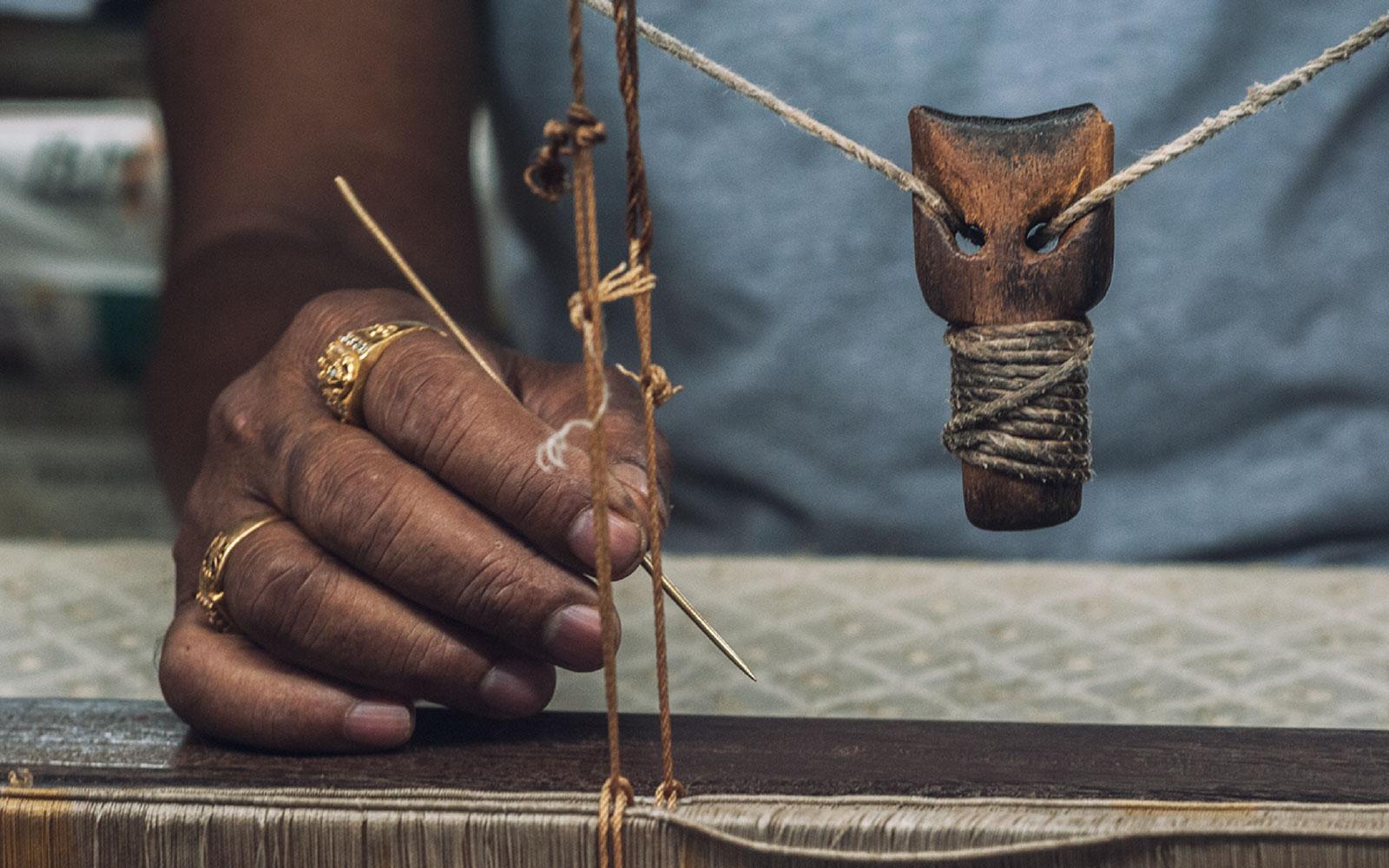Master weaver Jyotish Debnath sits at his hand loom