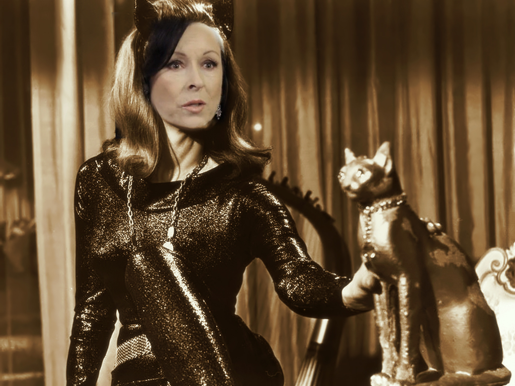 The ageless Ann Batley Burton (lady has nine lives after all) reprises the role that Julie Newmar made famous. She would have preferred Pussy Galore in a remake of Goldfinger but declined when she discovered that James Bond was going to be played by Idris Alba