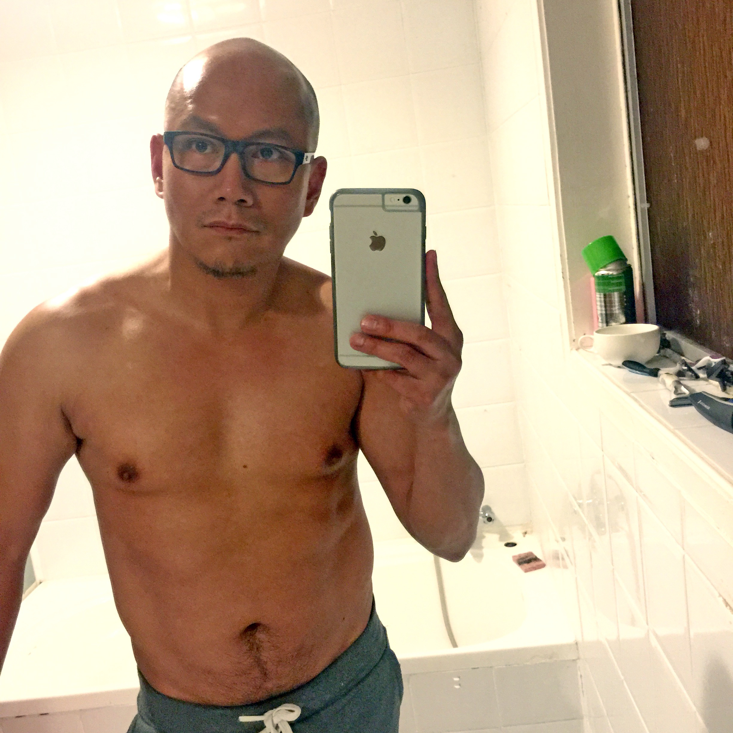 Shirtless selfie because I need to know if I'm getting fat or something. Sometimes you can't rely on a mirror. This is the old bathroom in Papakura.