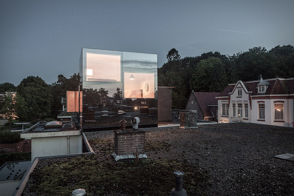 MIRROR MIRROR ROOF HOUSE  Sitting above the rooftops in The Netherlands, the Mirror Mirror Roof House puts all other tree houses to shame. Like its name implies, the cubed roof extension is clad in a mirrored glass, reflecting the landscape around it and making it almost disappear into the background. The double-height interior is completely sheathed in sheets of natural pinewood, housing an office and a floating steel bedroom. Large openings on every wall not only allow in plenty of sunlight but also provide continuous views of the surround treetops. Not too shabby for a 12-year-old boy.