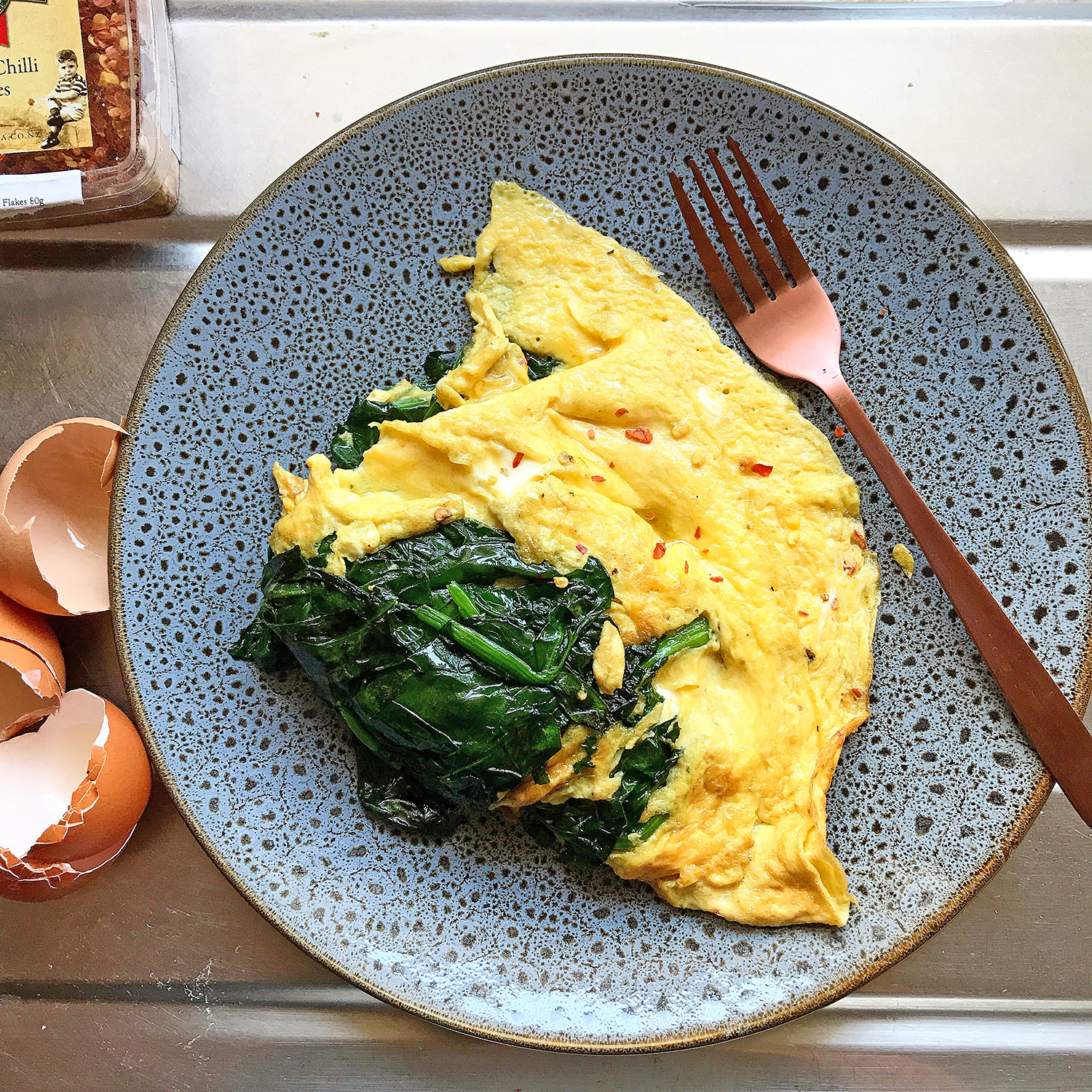 If I had a choice, I would have grilled pork belly, steamed shrimps, 'inihaw na bangus' and a salad of steamed okra, tomatoes and seaweed. But this three-egg spinach omelette would have to do.