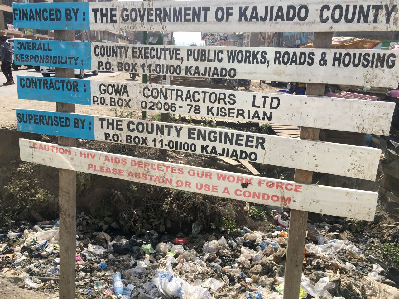 Out and about in Rongai -Note the bottom sign!
