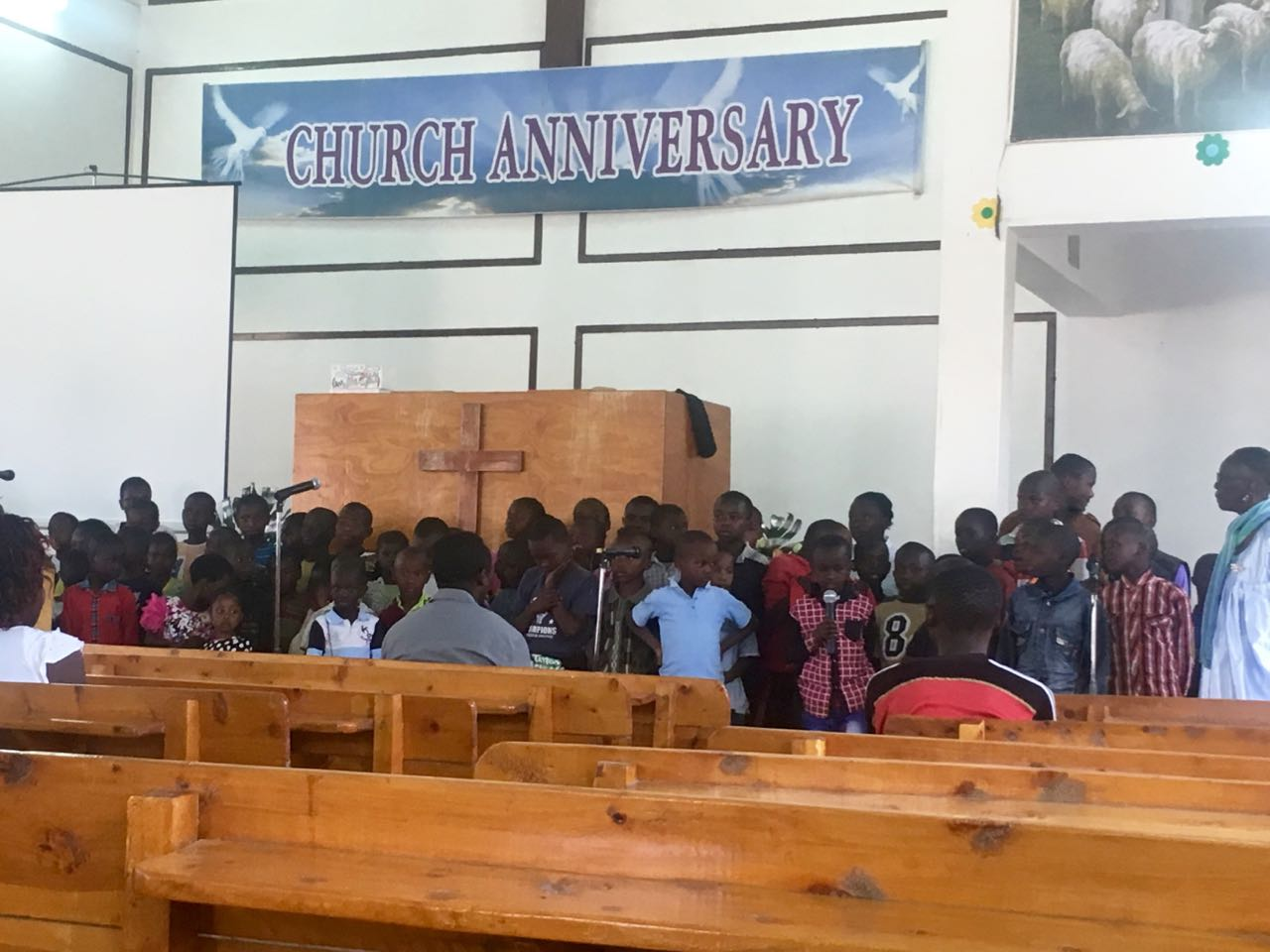 Sunday school kids singing for the 16 year anniversary of the church