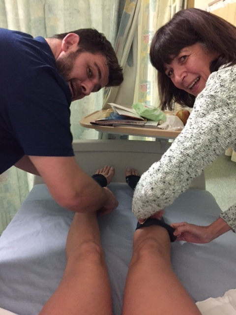 Mum and Rob pulling on my compression socks!