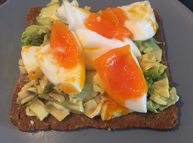 Sunflower and rice bread with avocado and egg