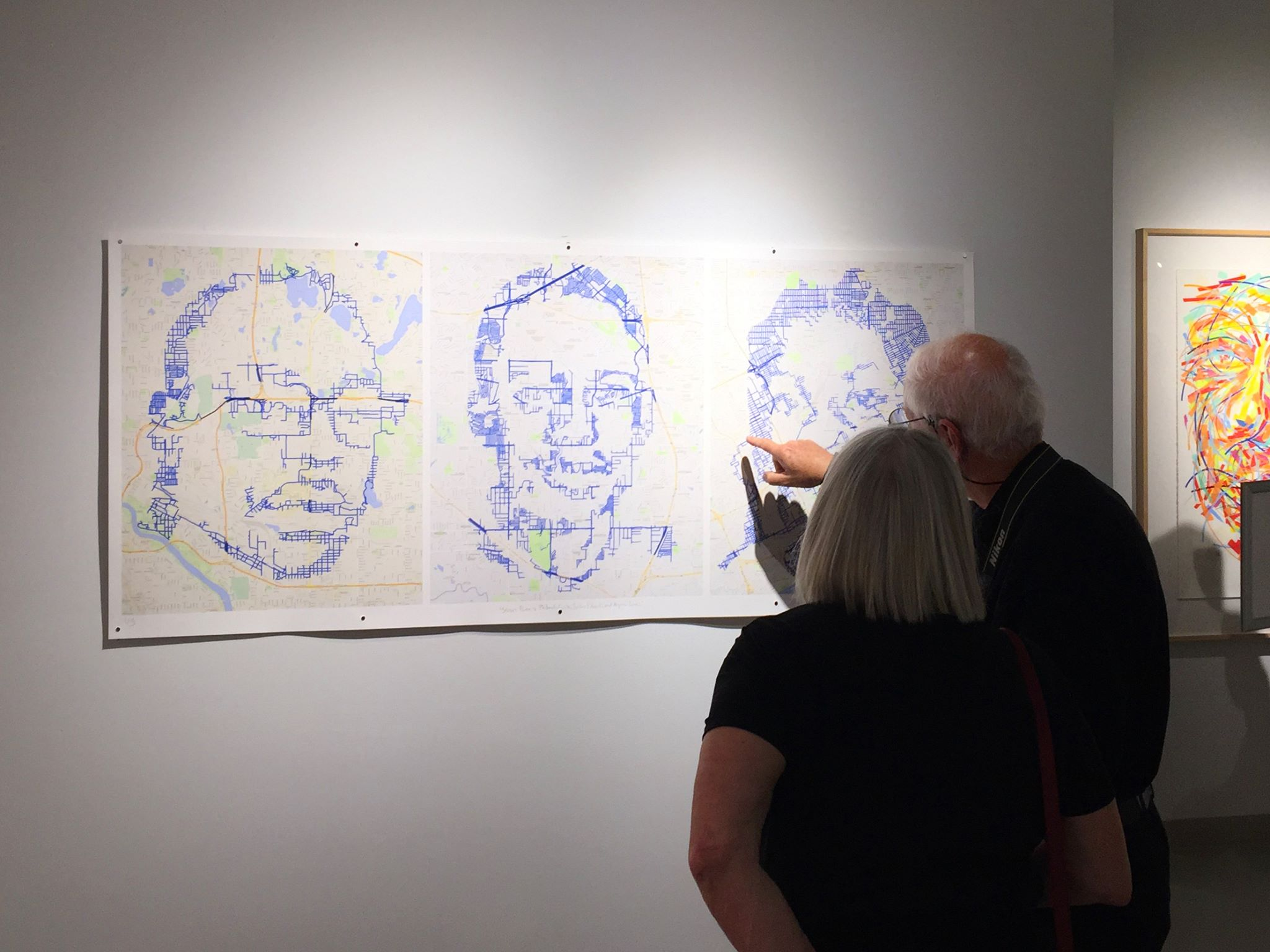 """At the Michigan Fine Arts Competition exhibition, people are following the key points of my """"Street Portraits: Philando Castile, Jordan Edwards, and Aiyana Jones,"""" each drawn in one continuous line through the streets around St. Paul, Dallas and Detroit where they were killed."""
