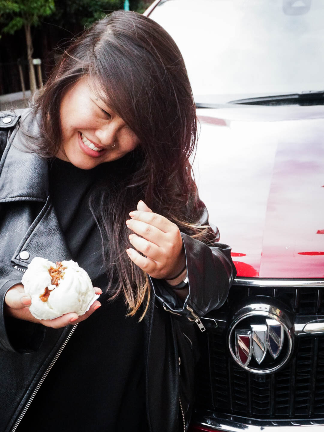 Bao from Good Mong Kok Bakery in San Francisco in front of Buick Enclave 2018