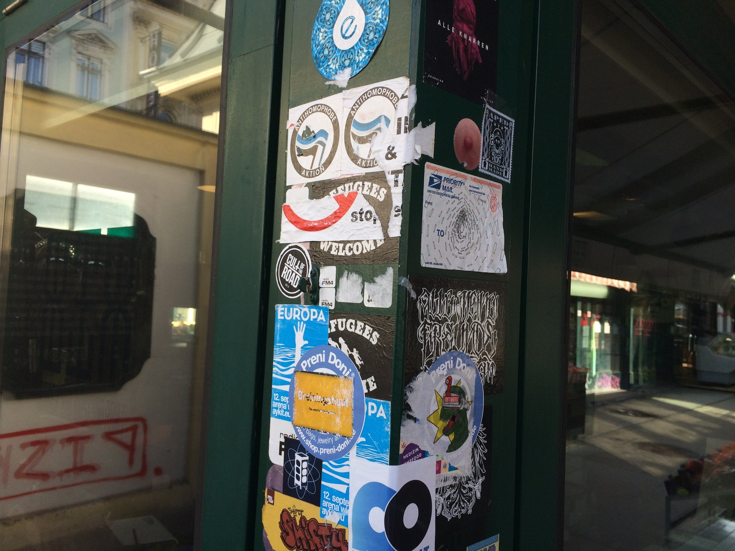 Support beam in Naschmarkt that has progressively been blanketed in stickers. Towards the upper right side of the shot you can see one variety of chimp stickers that are present throughout the city.