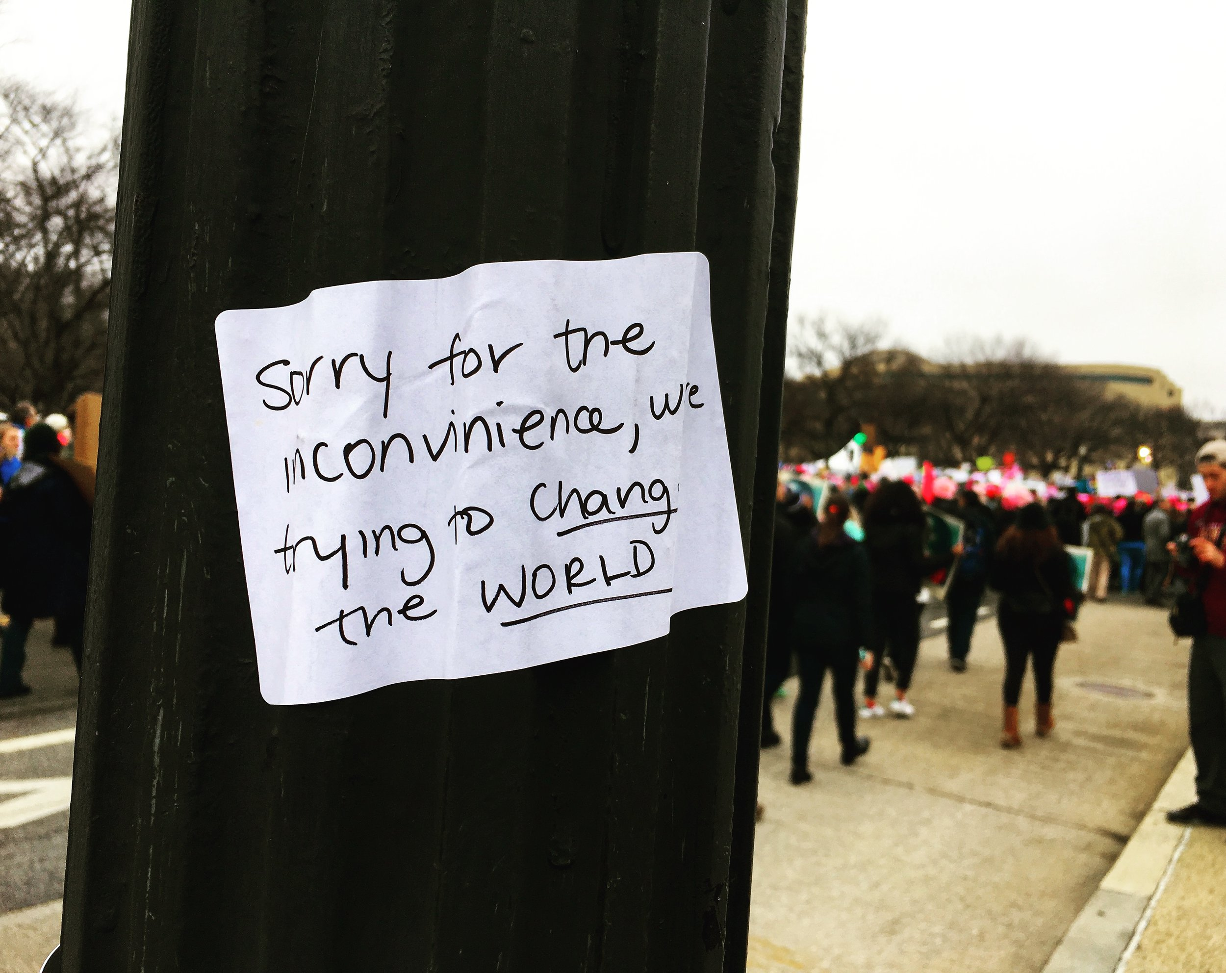 A handwritten sticker on a lamppost, which really set the tone for the day. (Sheila Murray)