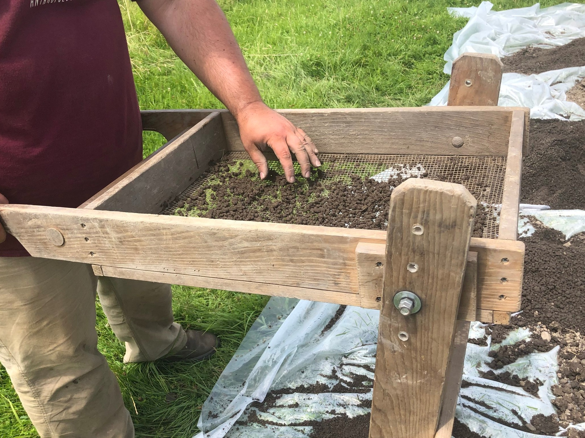 Any soil removed from the dig site must be carefully screened for potential traces of building materials and other artifacts. (Photo credit: Nicole Roché)