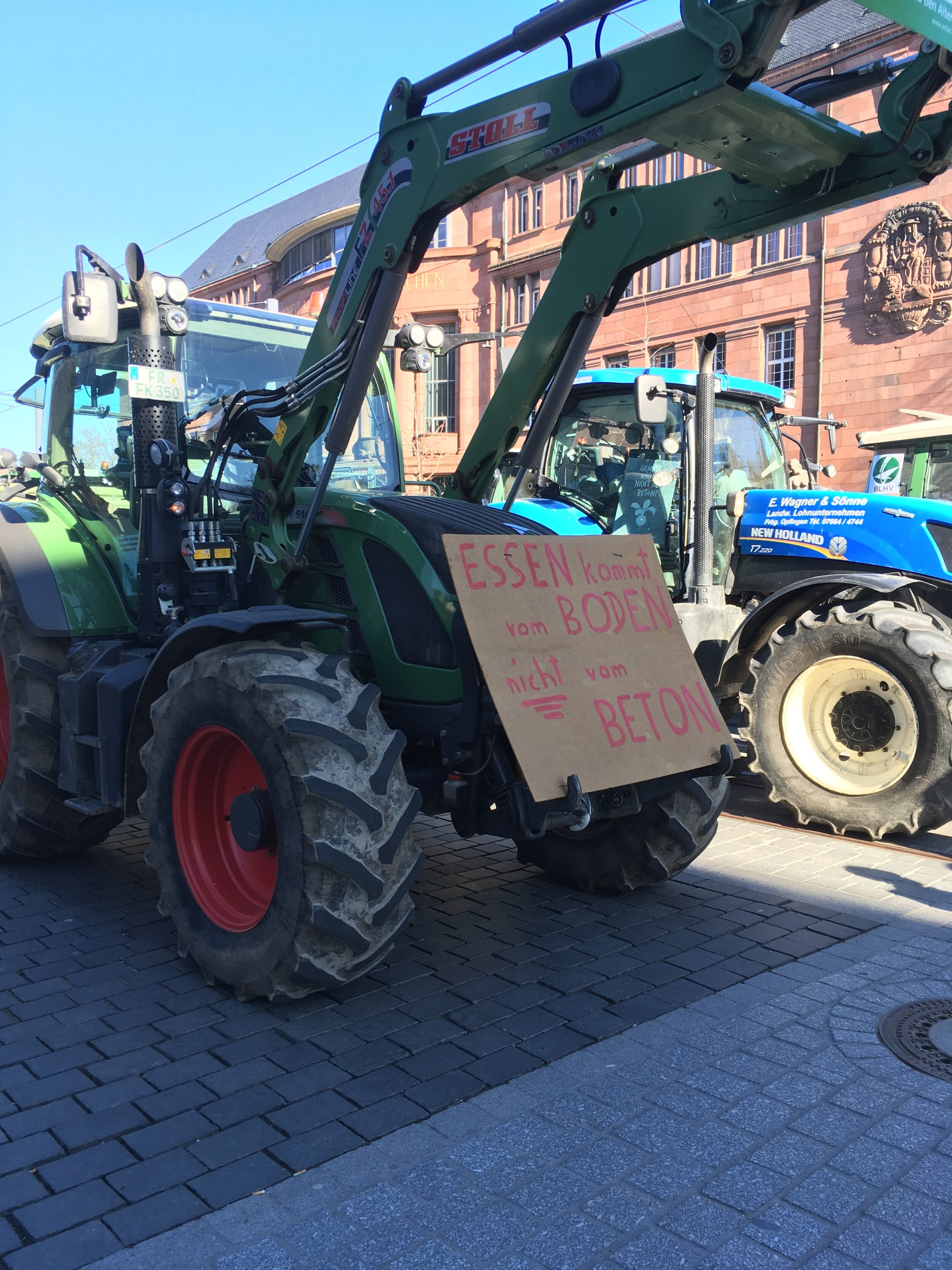 Pro-farmer slogans are paraded through the center of town. (Photo: Brendan Reilly)