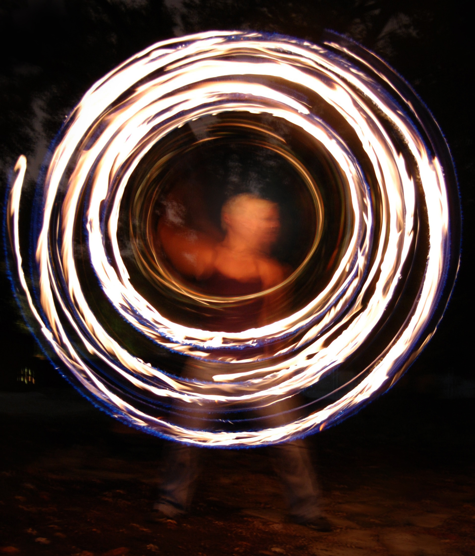 Kim Eitze fire hoop pic by Andrea Aycock.jpg