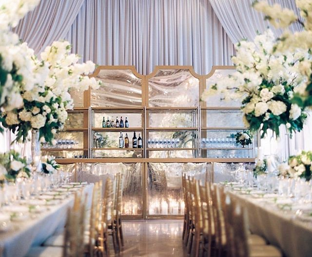 Candlelit bars ✨XO Planning and event design @blisschicago #blissweddingsandevents #blissevents Bars @northerndecor Draping and lighting @frostchicago Photo @kristinlavoiephoto