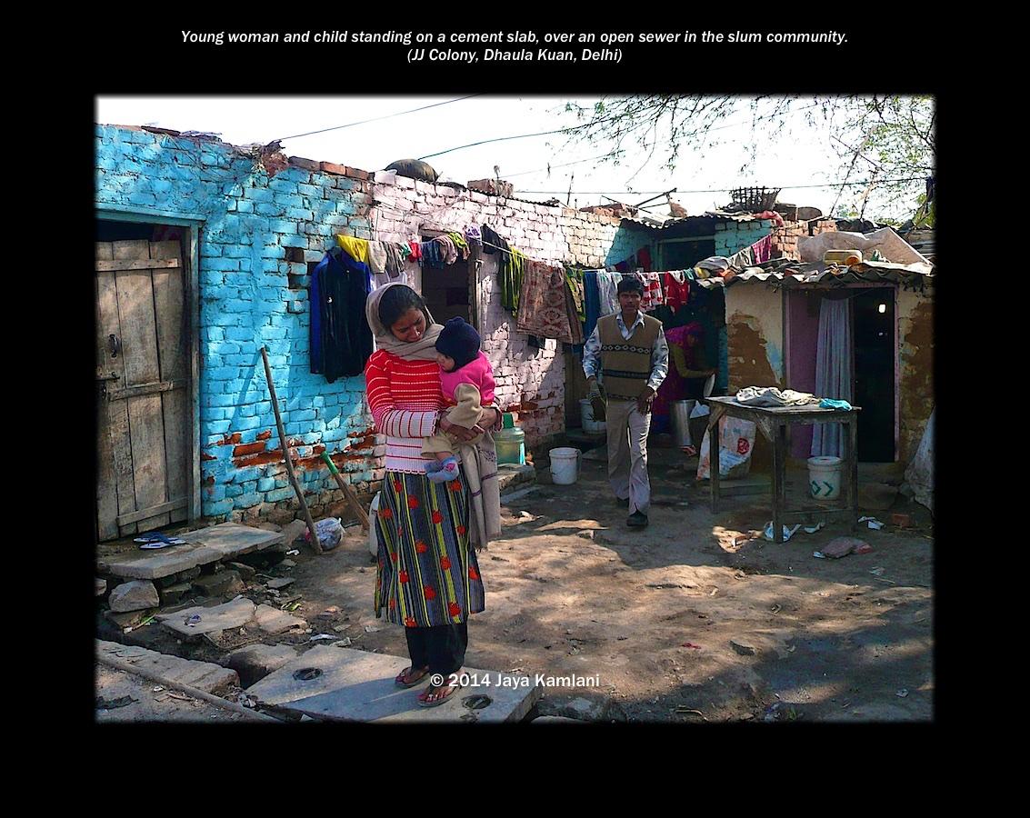 delhi_slums_woman_over_sewer.jpg