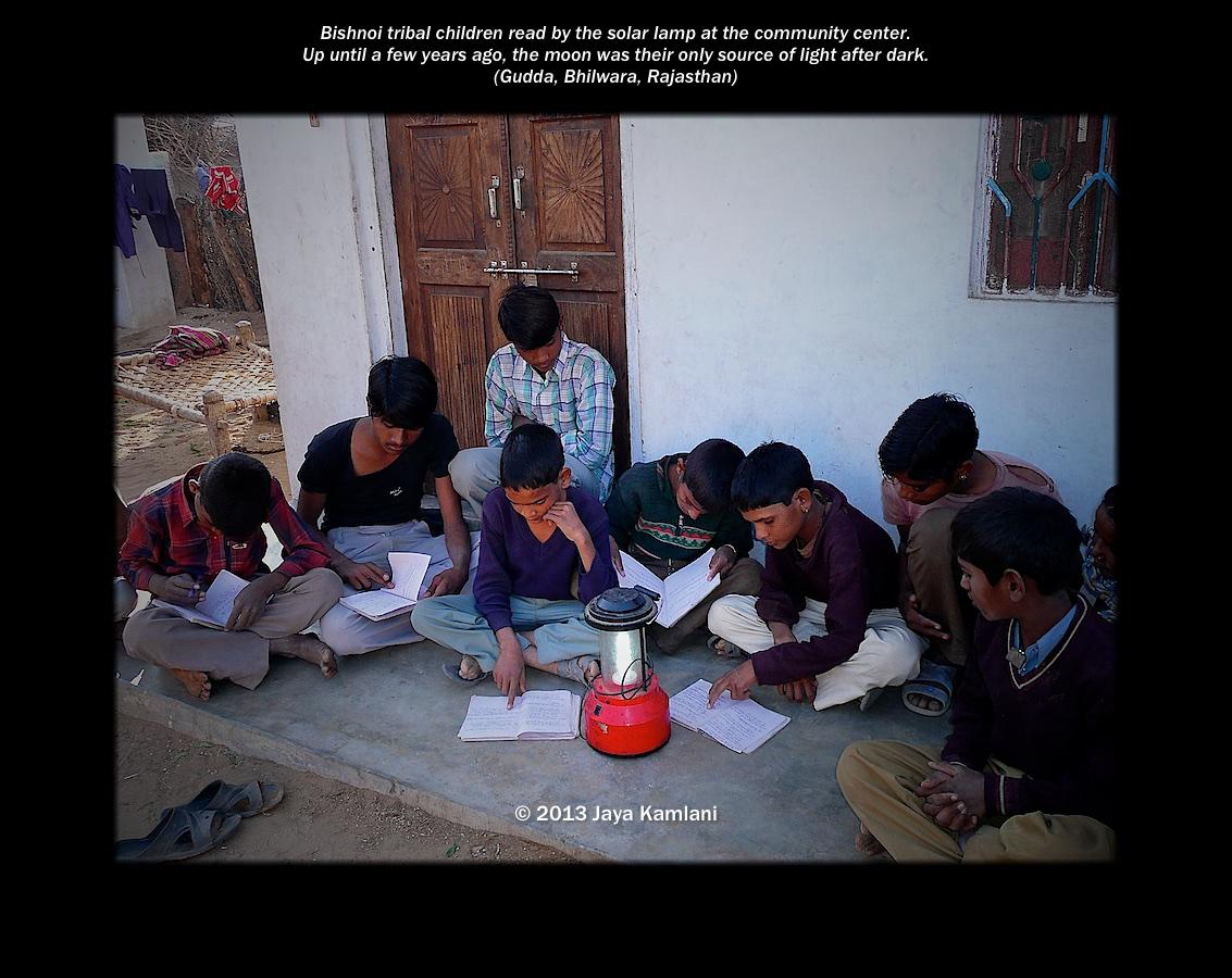 rajasthan_tribal_children_reading_by_solar_lamps.jpg