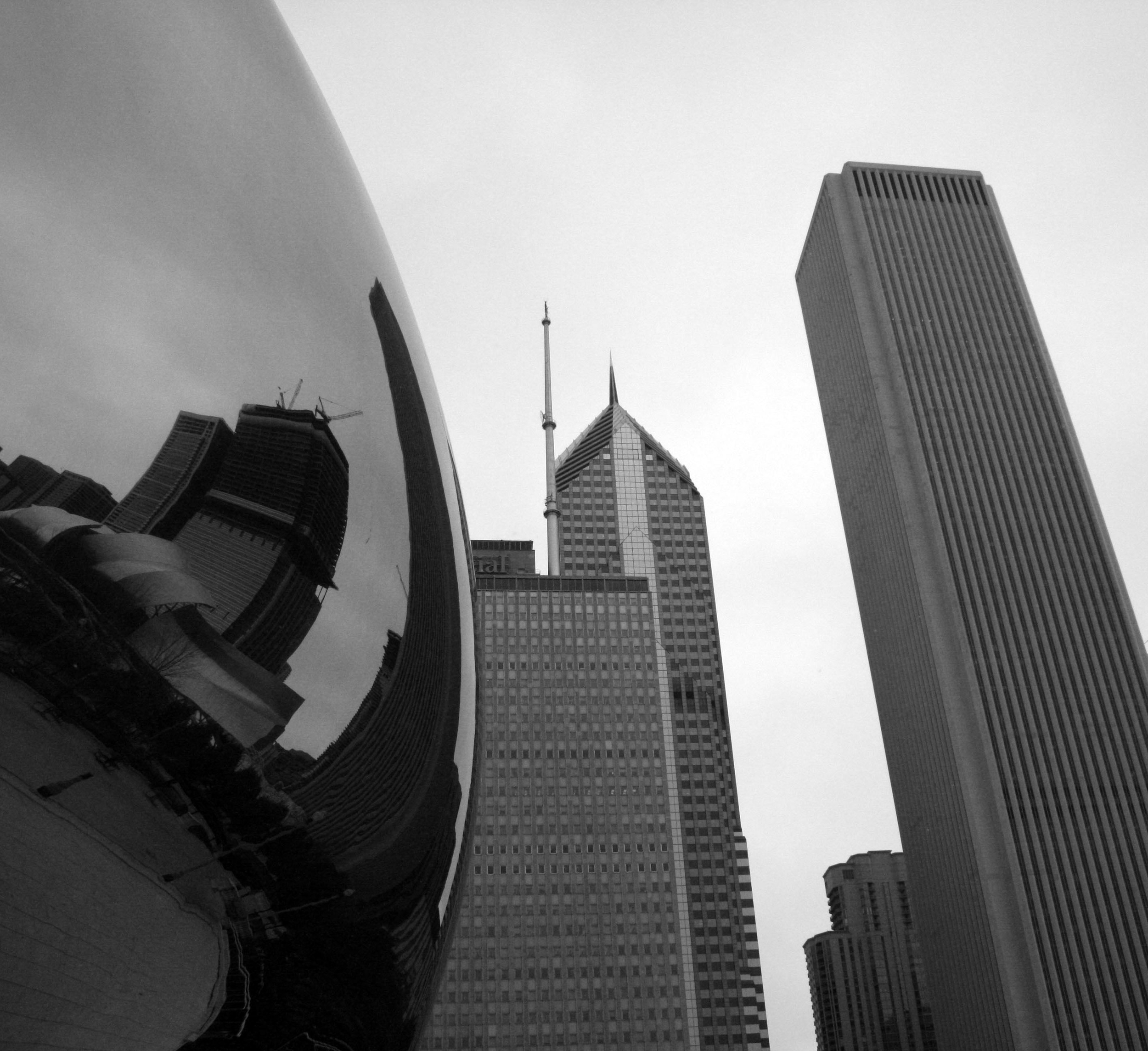 Chicago's skyline reflects in the Cloud Gate sculpture in Millennium Park.