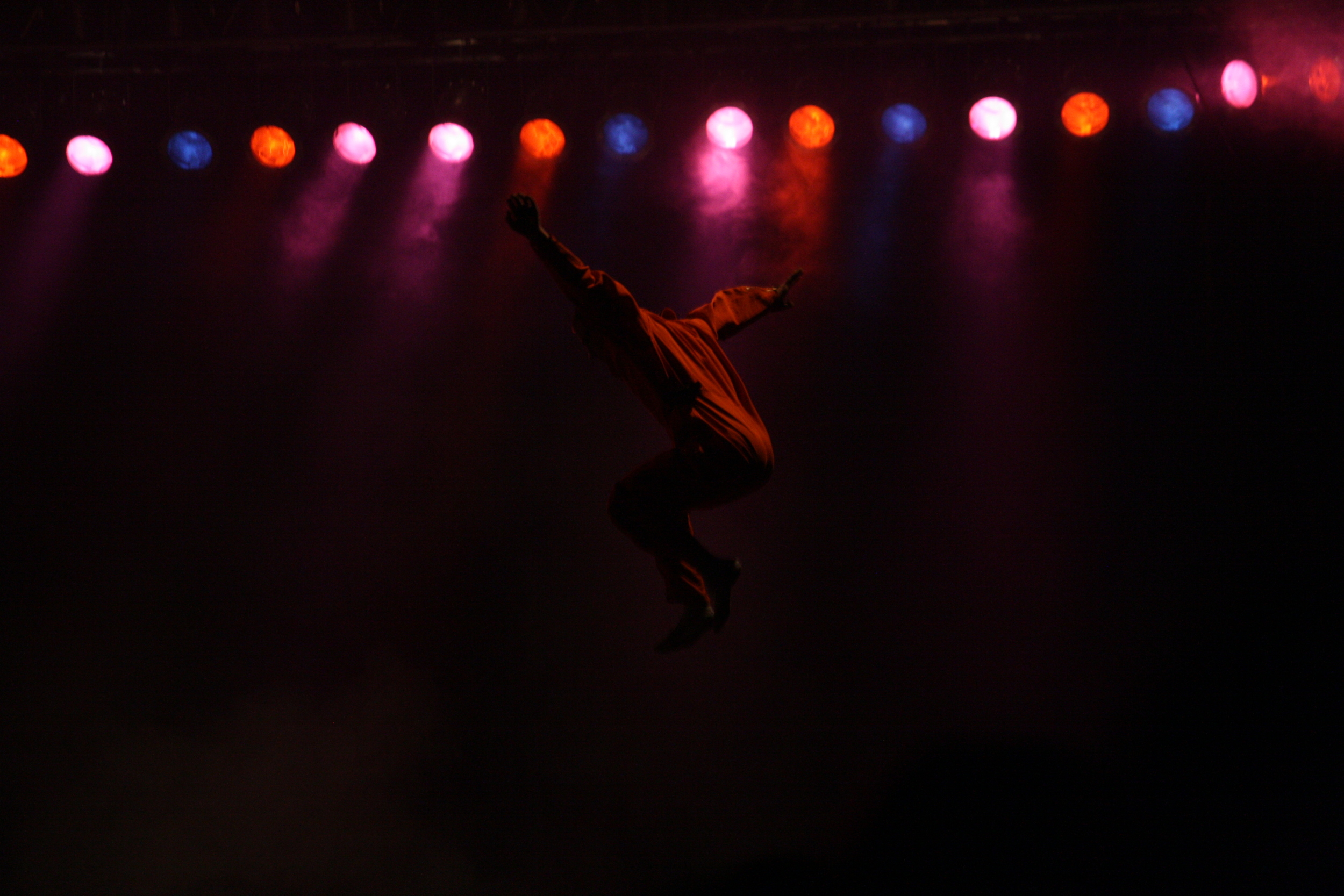 A performer leaps high above the stage at the Three Rivers Arts Festival in Pittsburgh.