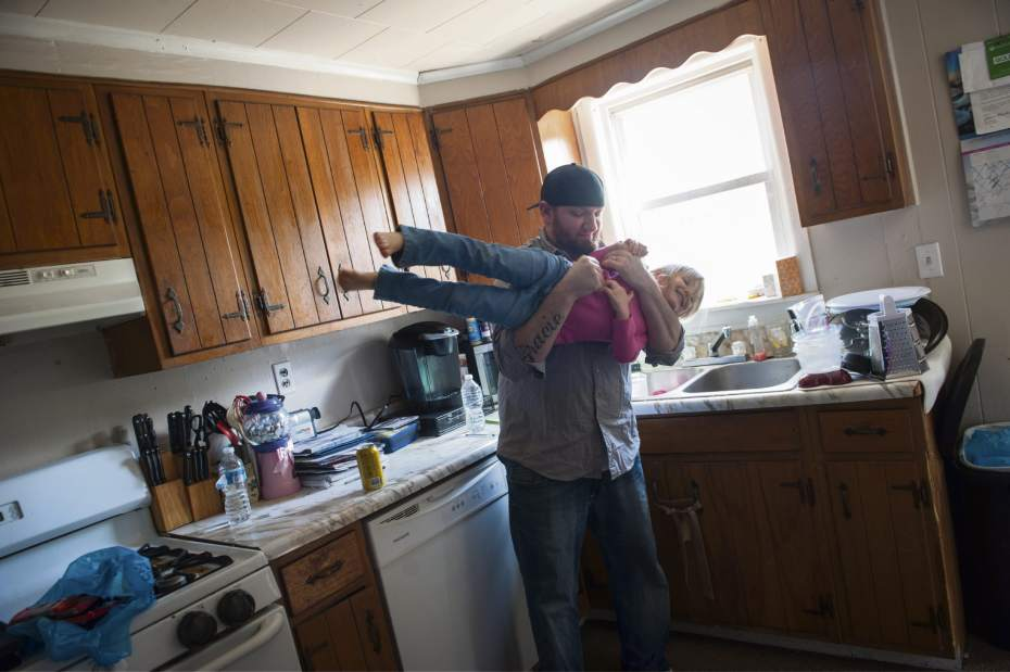 Former coal miner Ted FInk takes a break from packing up his home to play with his daughter, Gracie, 3.  Photo credit:  Stephanie Strasburg