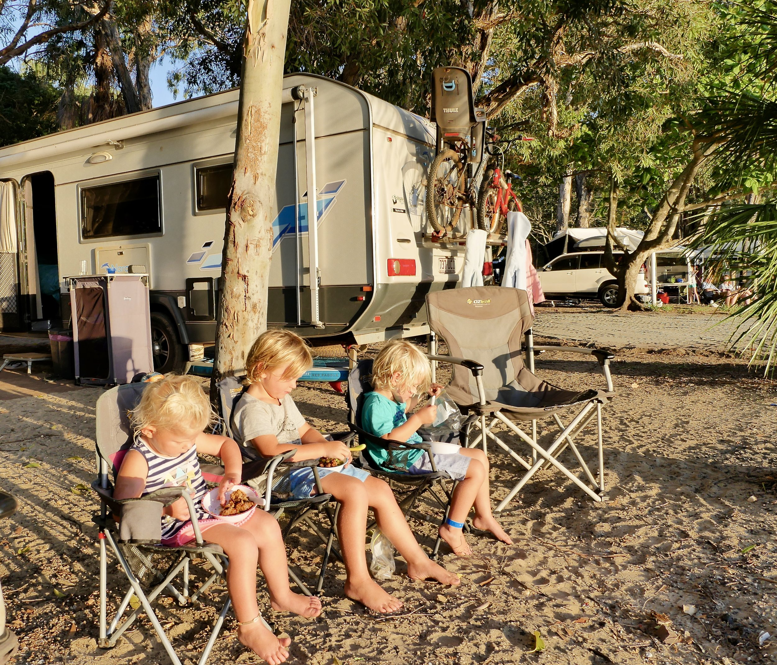 kids having dinner while watching the sunset at 1770, qld.