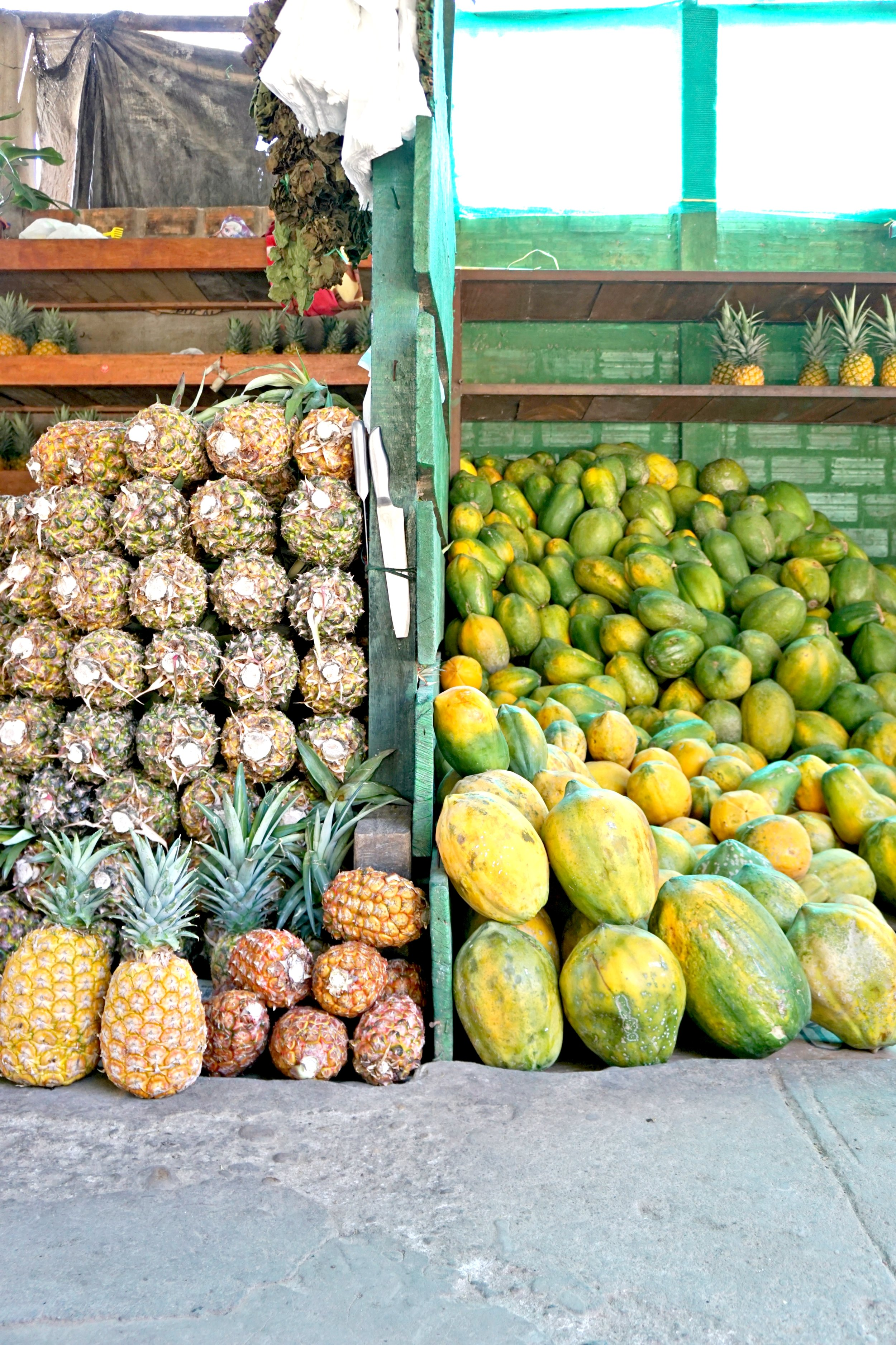 Pineapples & papayas stacked high in Tarapoto. The more yellow the pineapple the more expensive...apparently.
