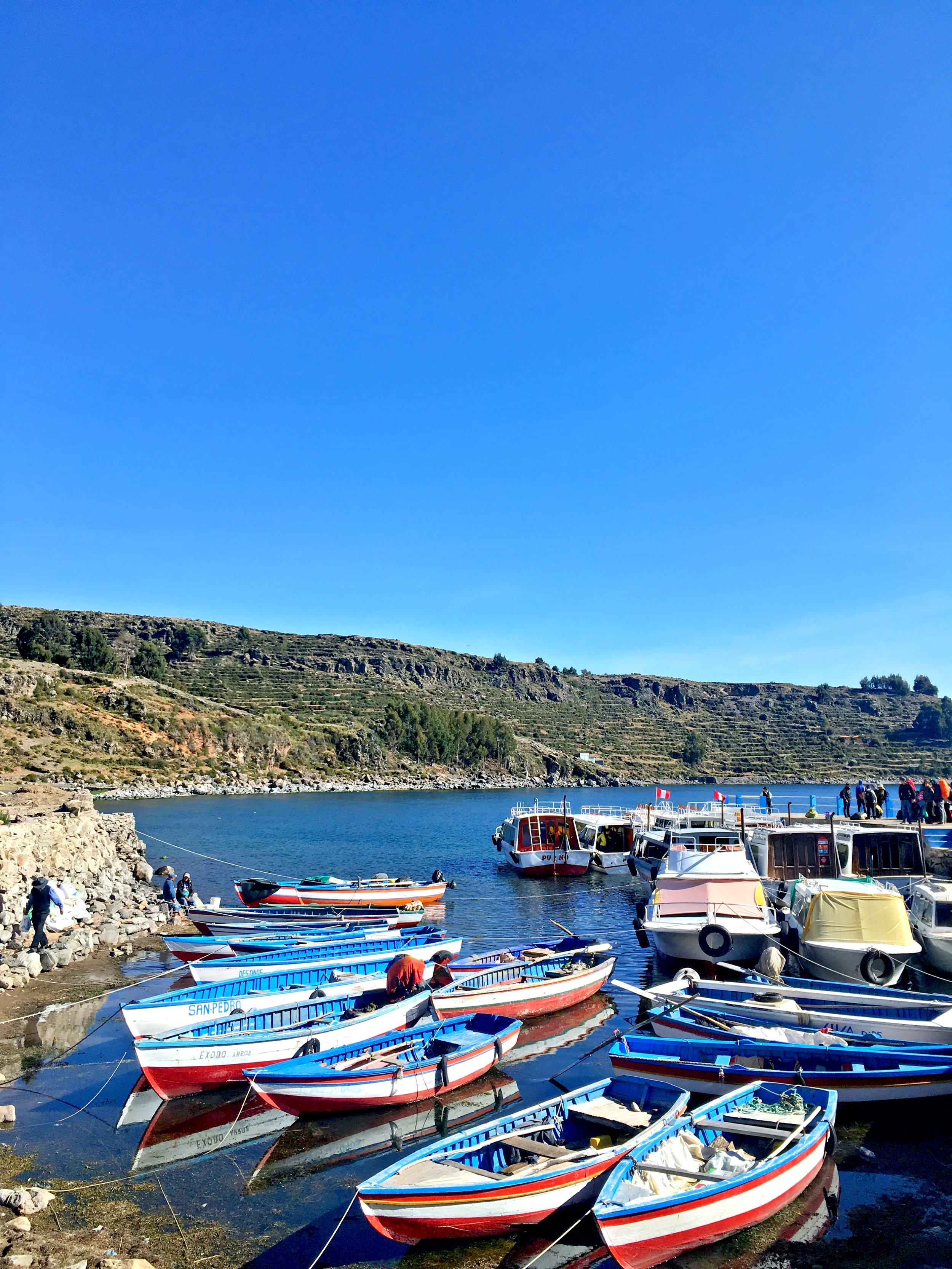 Boats docked on Amantani Island