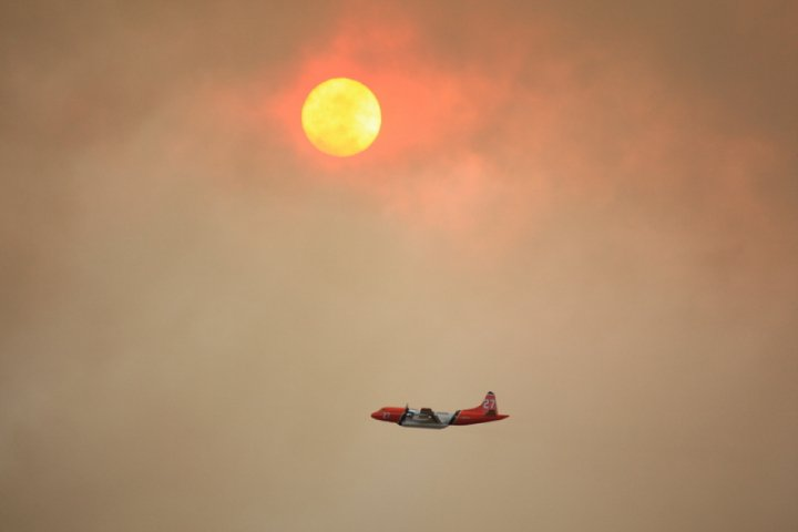 The Eerie sight of the sun tinted red from smoke.