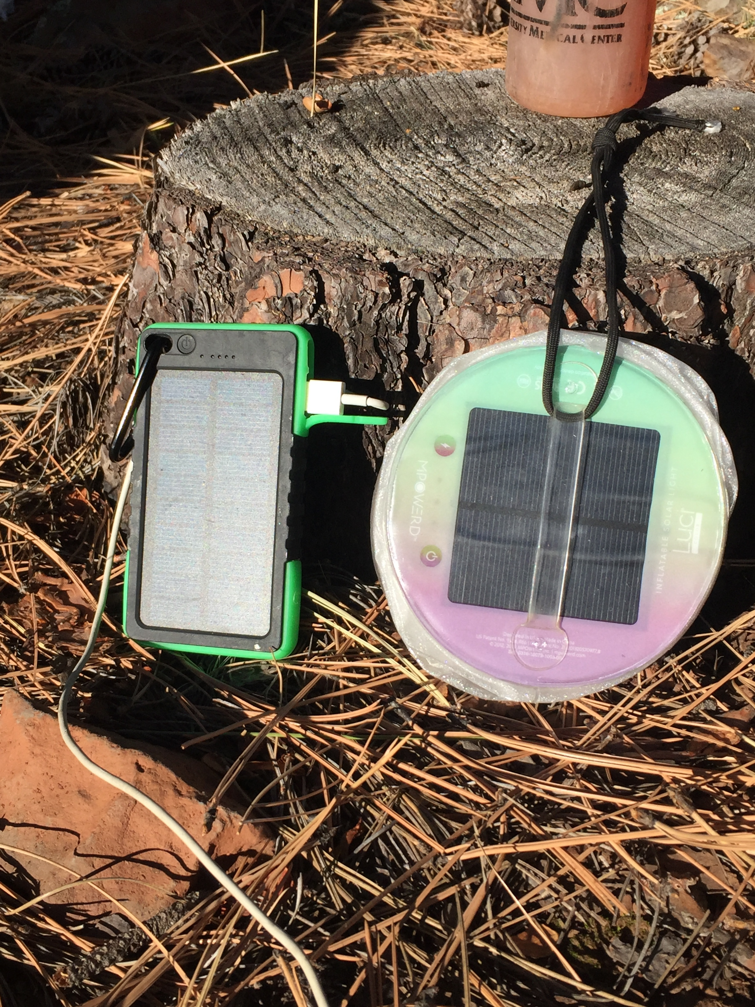 Last but not least, an up close of my solar power soaking up the sun. On the right is the previously mentioned   Luci Light  . On the left is the phone charger I was carrying that fell off. (Dang it!) It can be charged from a plug at home to carry extra power for your phone and is then supposed to recharge from the sun. I can attest to the fact that is will indeed charge from the wall, and hold a charge to refuel your phone. Because it fell off and got lost, I can't attest to how well the solar part works. If you want to try one yourself, it was very inexpensive. I had one similar to   THIS  . I'm hoping for a new one for Christmas and once I test out the solar functioning, I'll let you know. For the price though, even if the solar part isn't perfect, it is worth it for the bonus battery pack aspect.