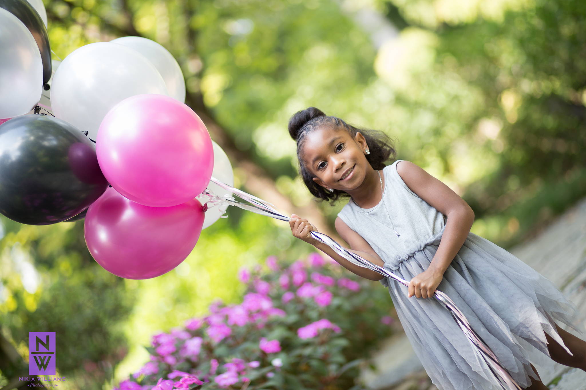 Reagan's colorful birthday balloons add a pop of color to her session! Photo By Nikia Williams