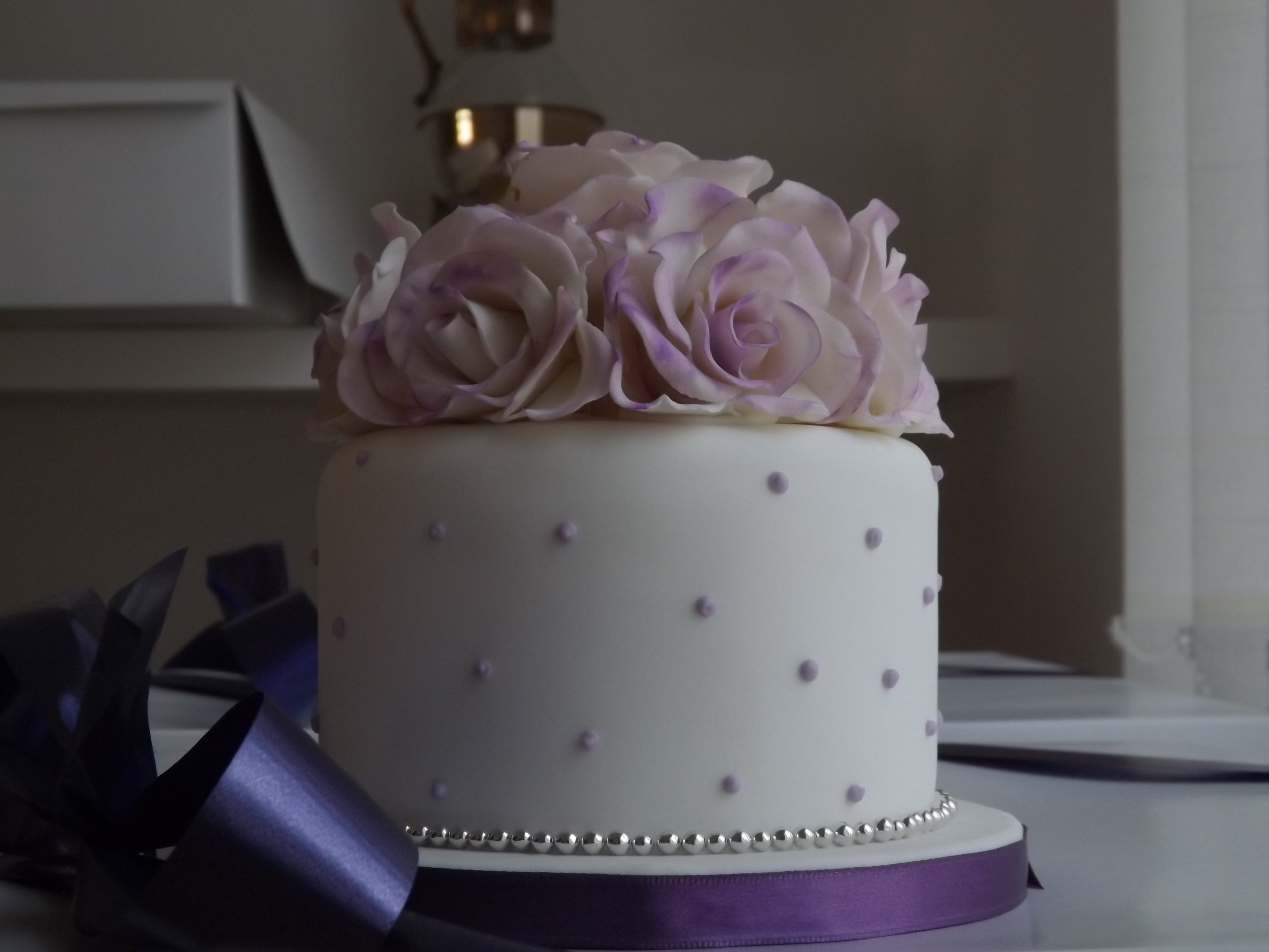 Purple flowers wedding cake