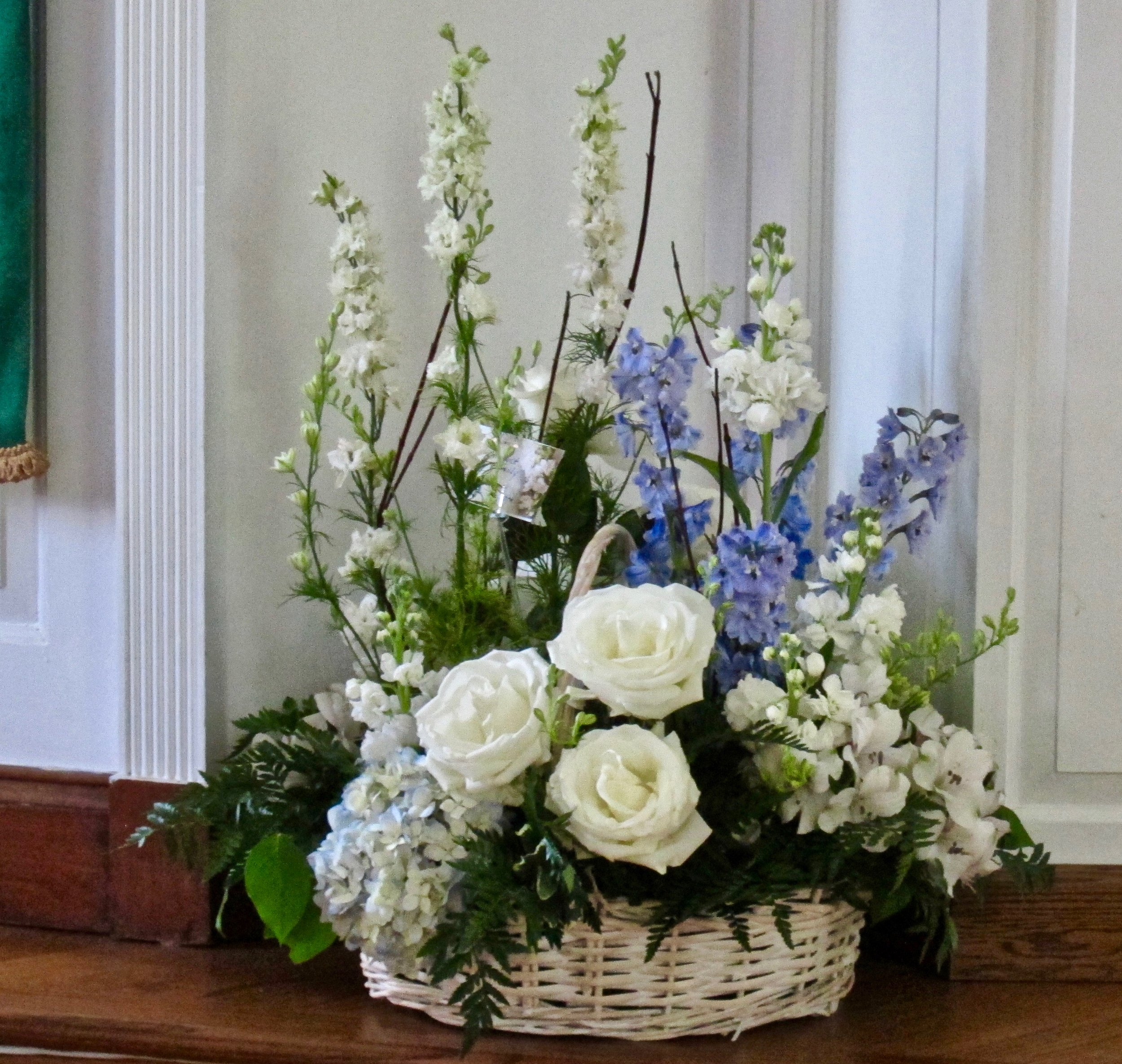 GARDEN SERENITY White larkspur, roses, alstroemeria with blue delphinium and hydrangeas, large $95 to extra large for floor display, $150.