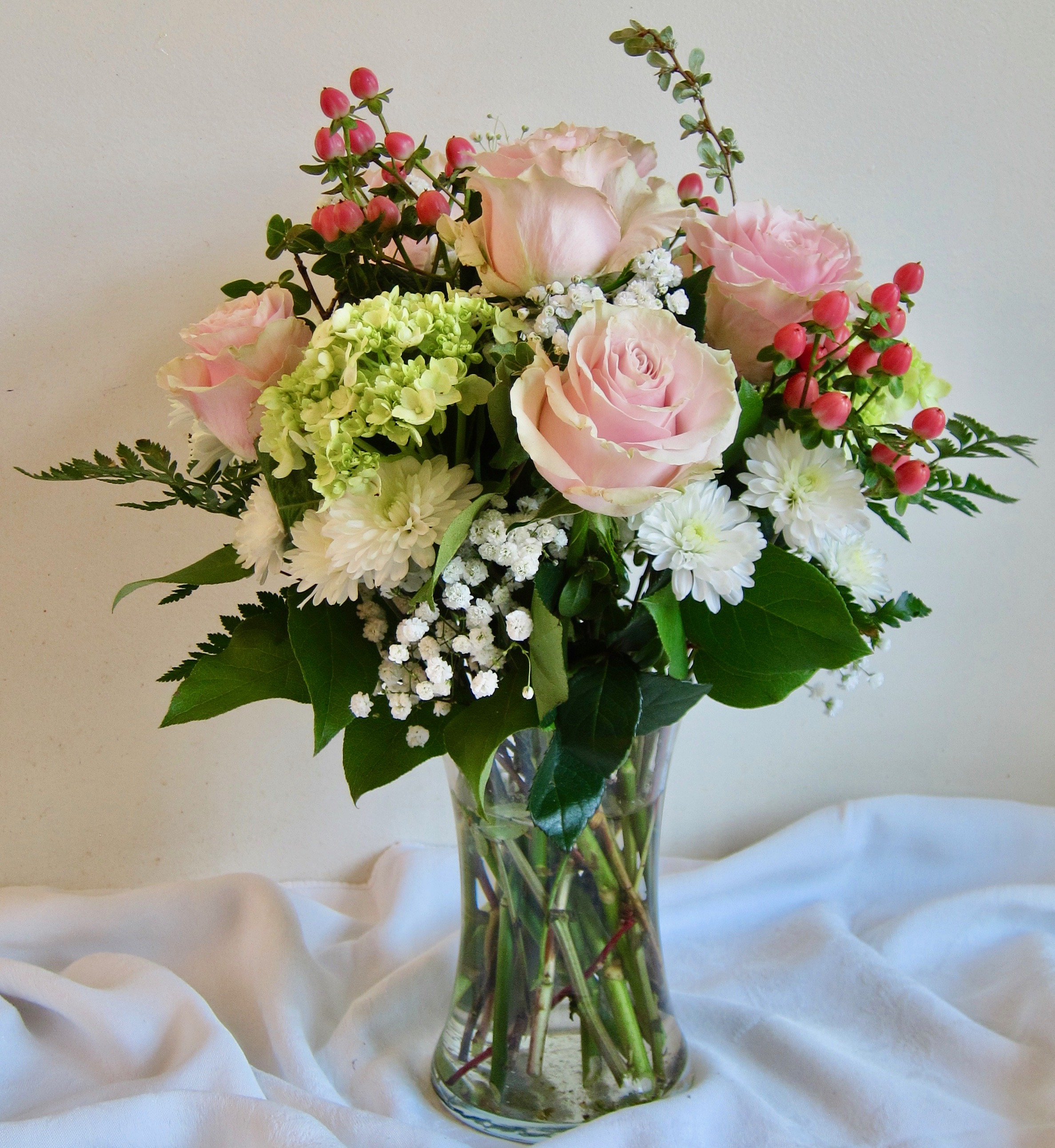 ELEGANT   lime green hydrangeas and blush roses with berries and white accents, $75 and $95 sizes.