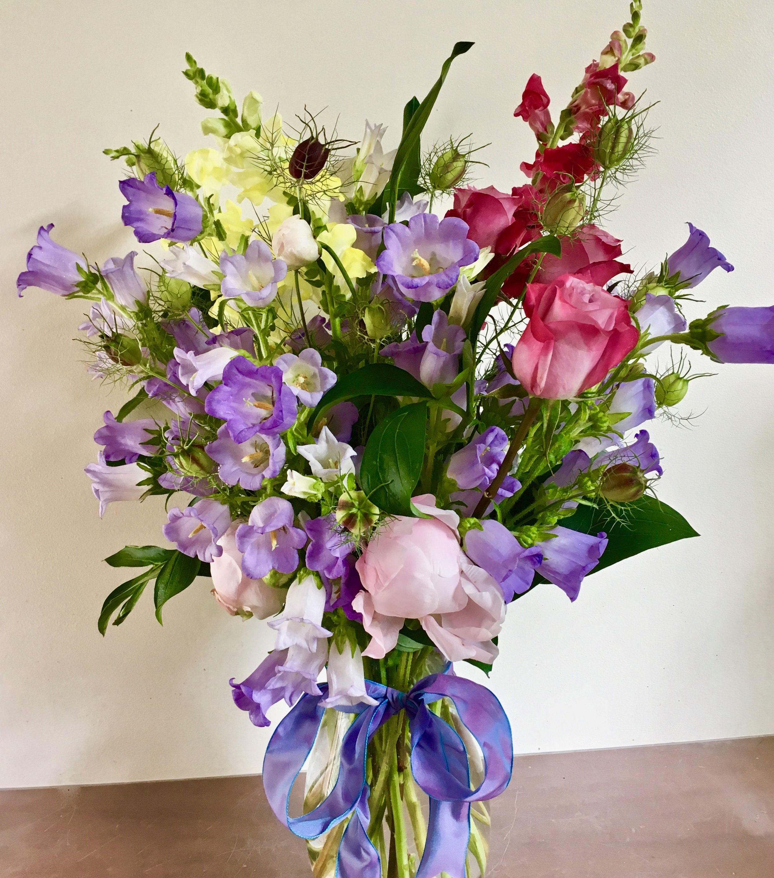 TALL SPRING FLOWERS   such as bellflowers, snapdragons, lisianthus and more. Large 9 inch vase, $65. Small 7 inch vase, $45.