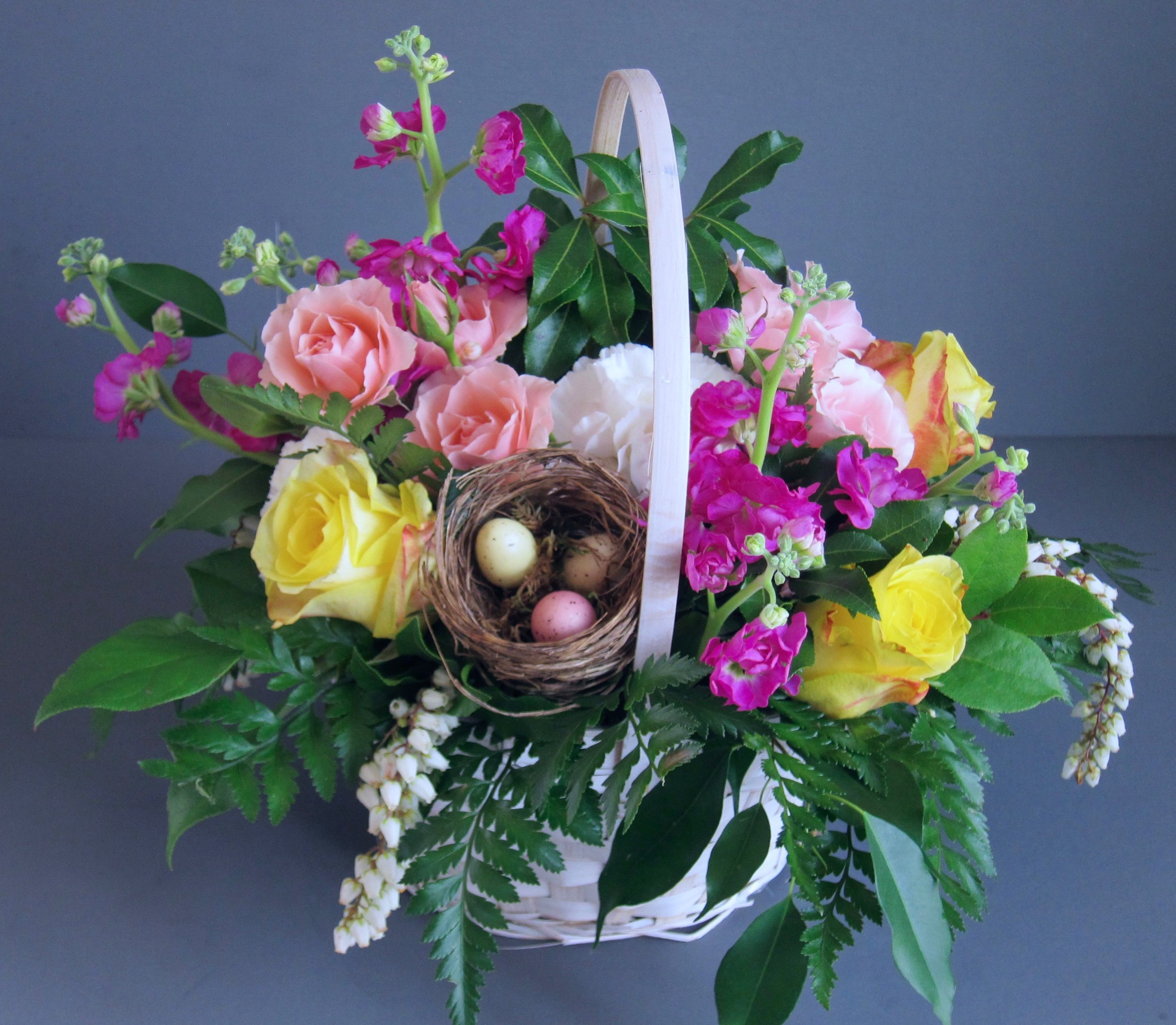 NATURE LOVER basket of spring flowers with birds nest nestled in a 7 inch basket, $45, our small size.