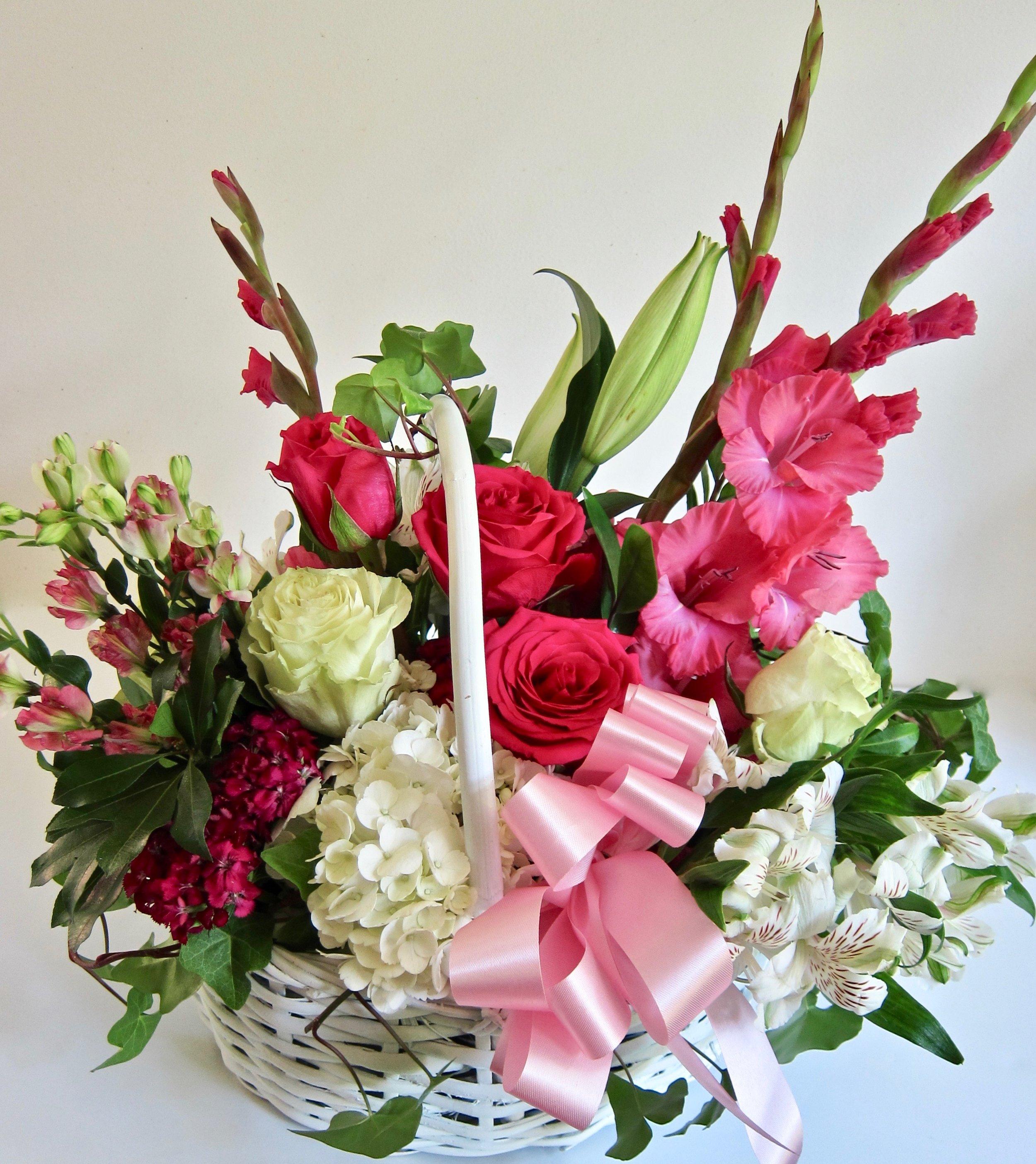 MEDIUM BASKET   Seasonal cut flowers in medium white basket, $75.