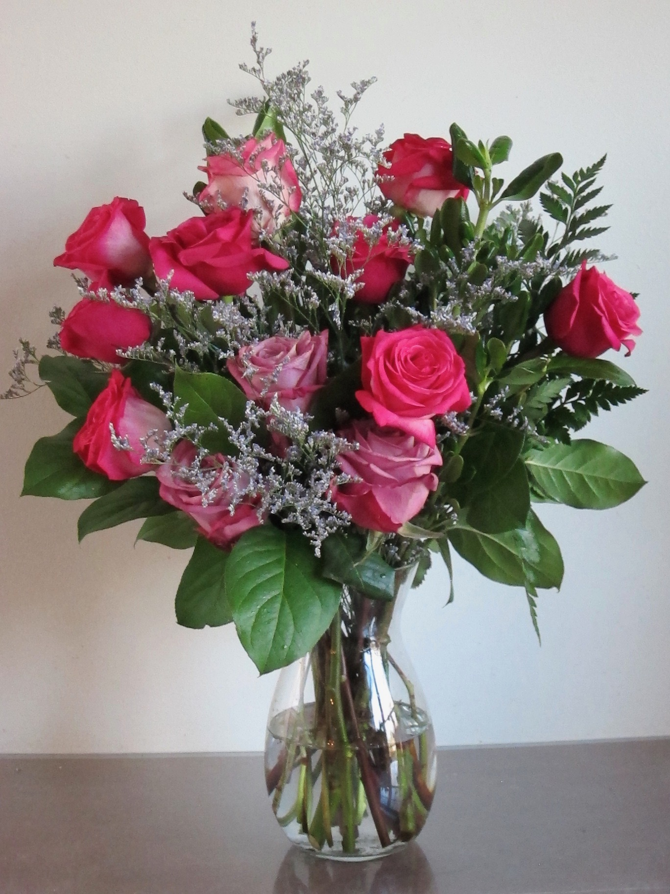 ROSE MEDLEYS    Roses accented with seasonal picks: half dozen, $50, twelve for $75, eighteen for $95.