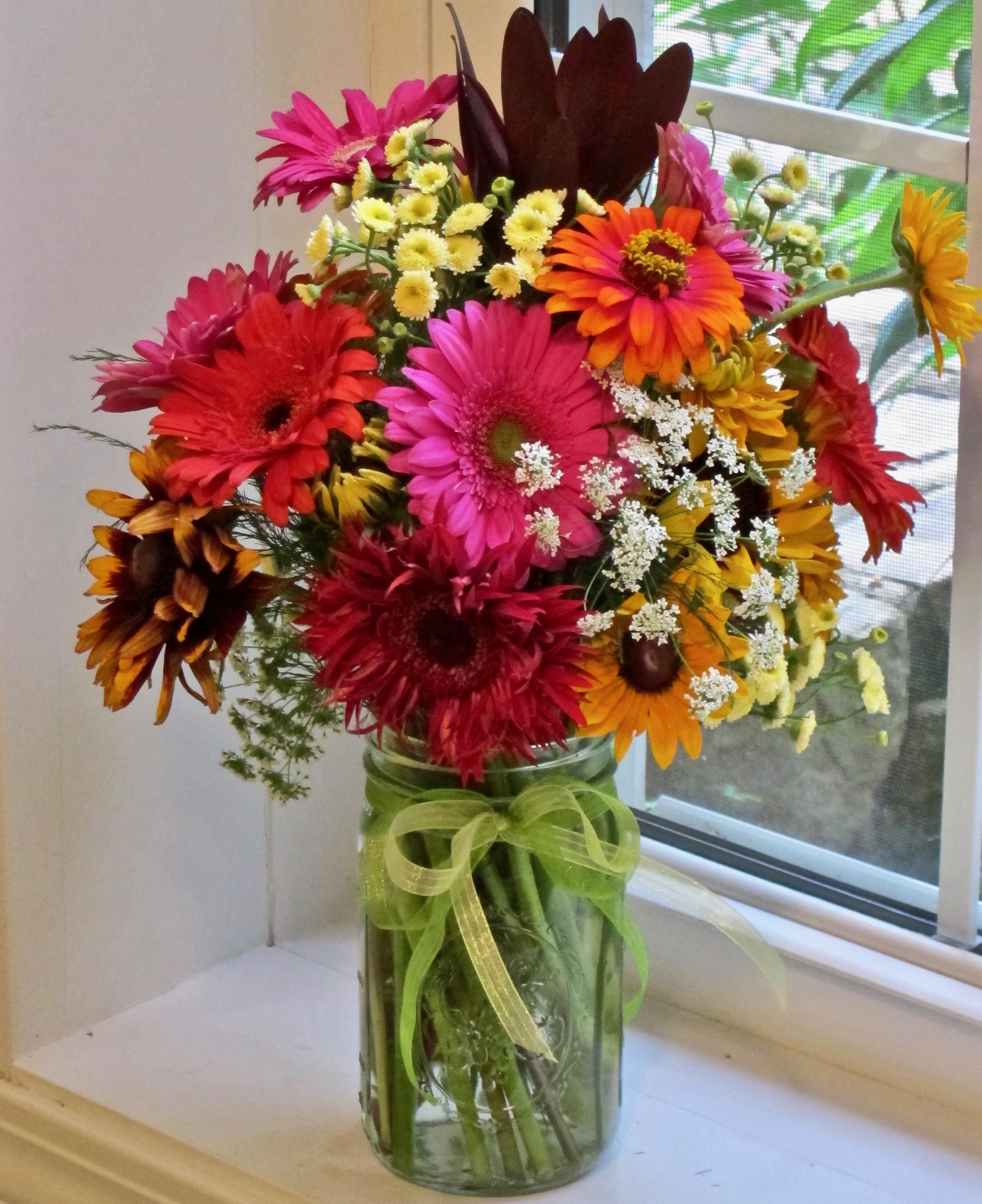 DAISY MEDLEY MASON JAR   of colorful seasonal asters such as gerbera daisies, rudebeckia, sunflowers, fever few, mums, $45.